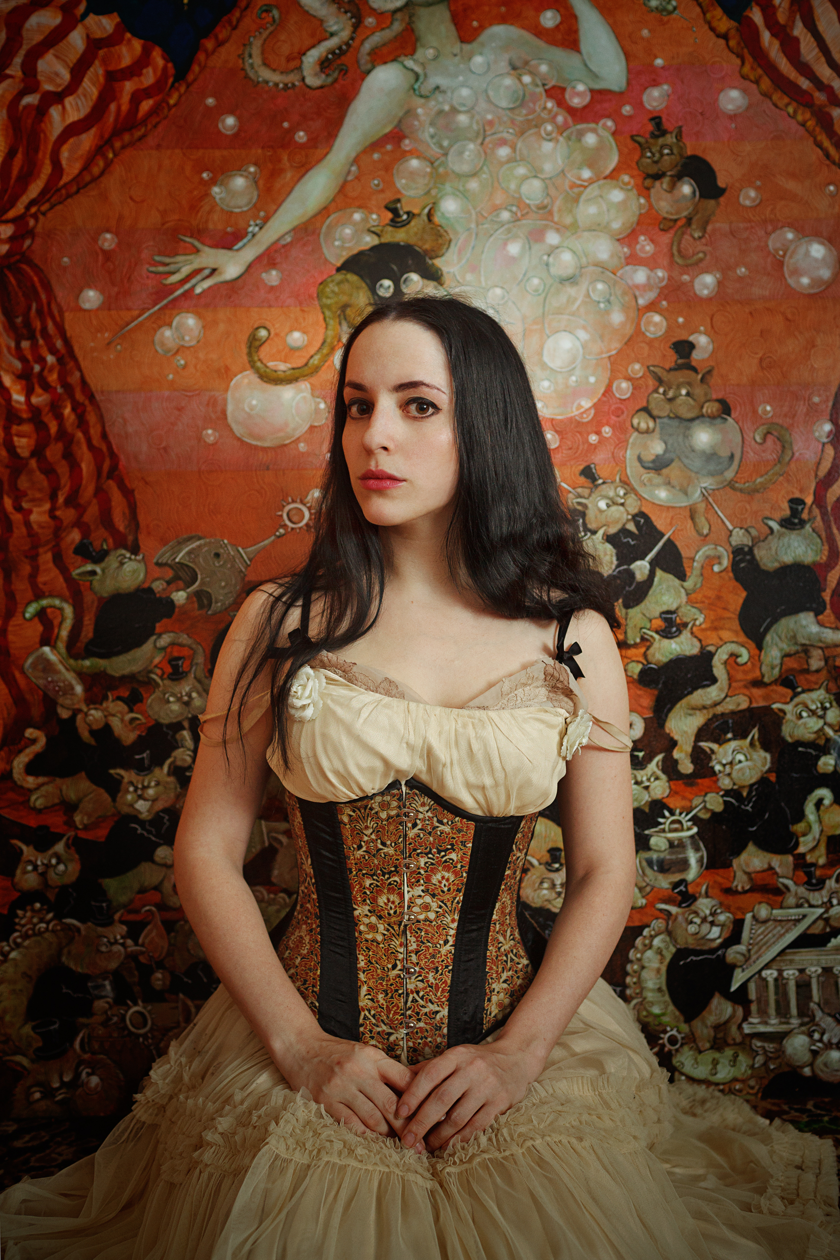 Molly Crabapple,  her posing in front of her Shell Game Series, 2012