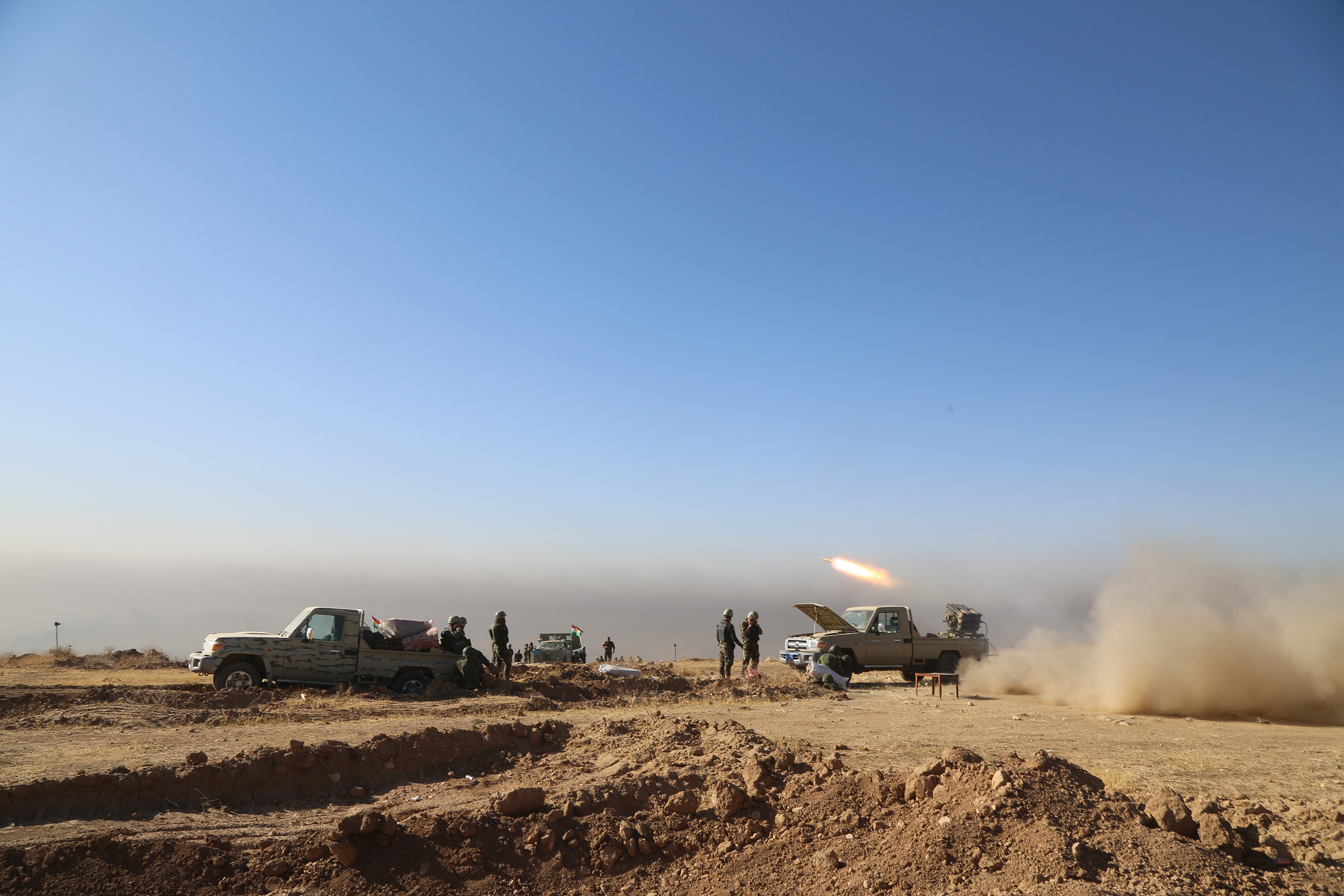 Kurdish Peshmerga forces located at Mount Zardak fire toward an ISIS position during an operation to retake Iraq's Mosul, held by the militant group since 2014, on Oct. 17, 2016.