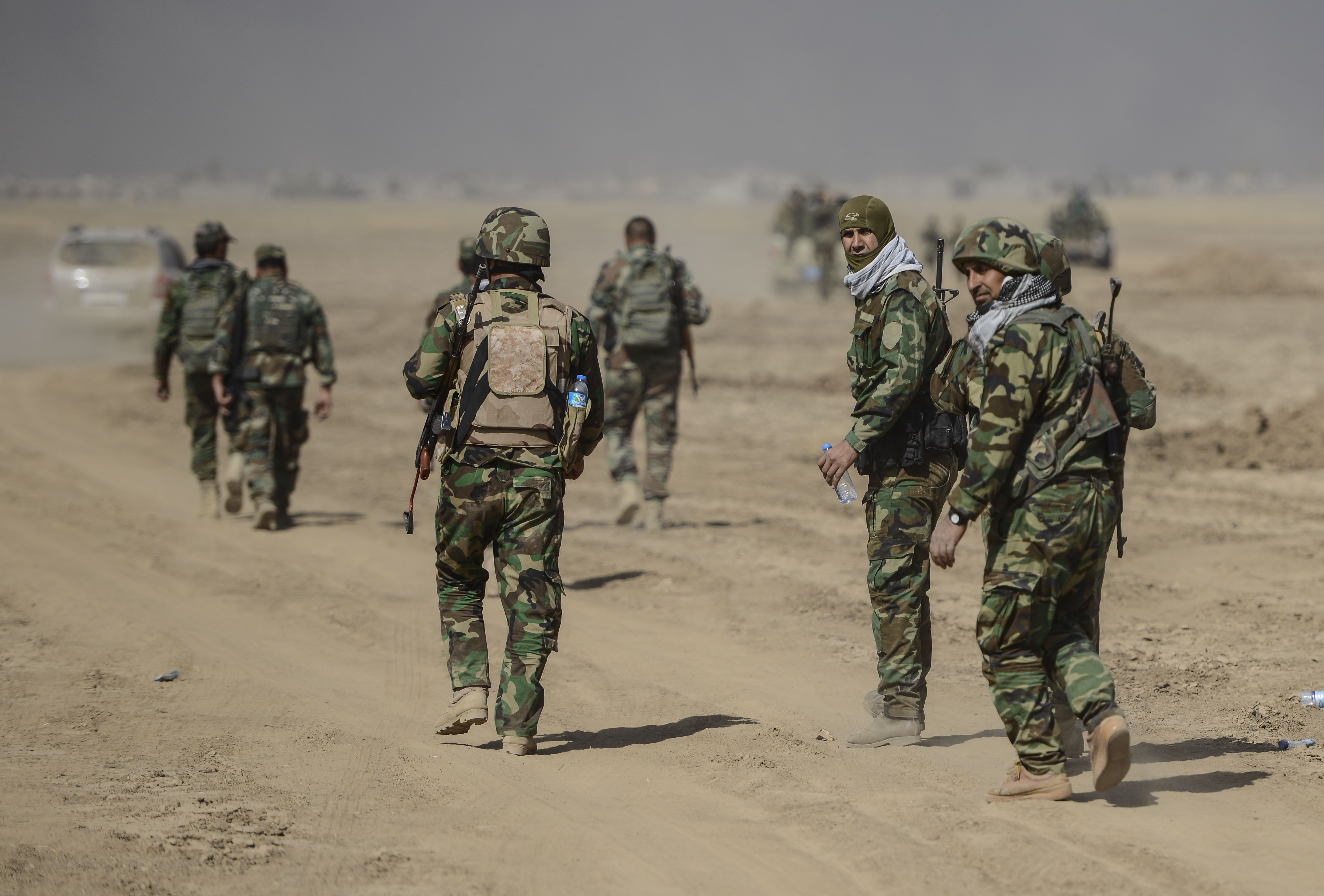 Peshmerga forces are seen at the Tarjala village as they attack on Deash targets during an operation to liberate Mosul from Daesh terrorist organization on October 17, 2016.
