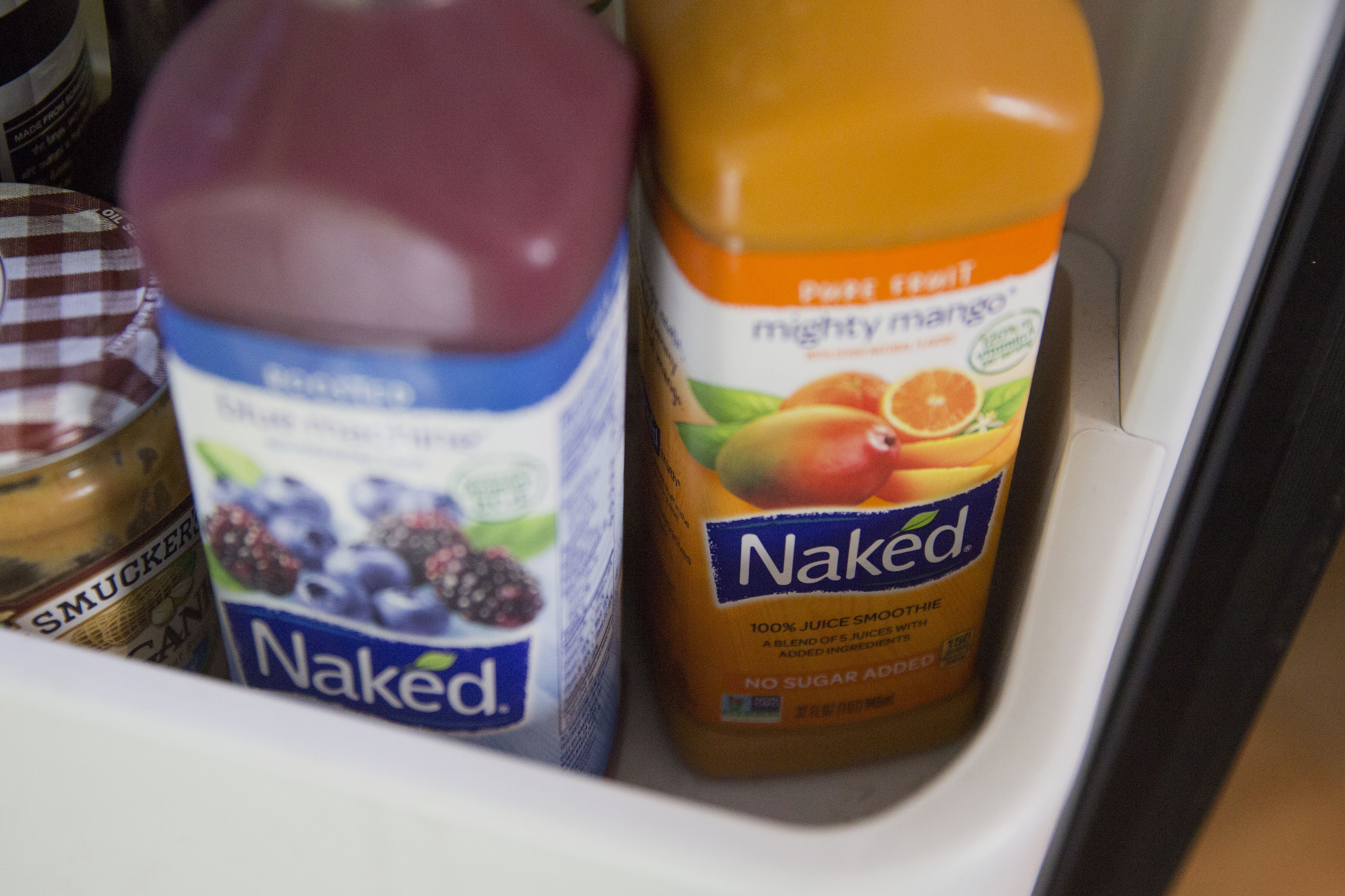 Bottles of PepsiCo Inc. Naked brand juice smoothies are arranged for a photograph in Tiskilwa, Illinois, U.S., on Thursday, July 2, 2015. PepsiCo Inc. is expected to report quarterly earnings on July 9, 2015.
