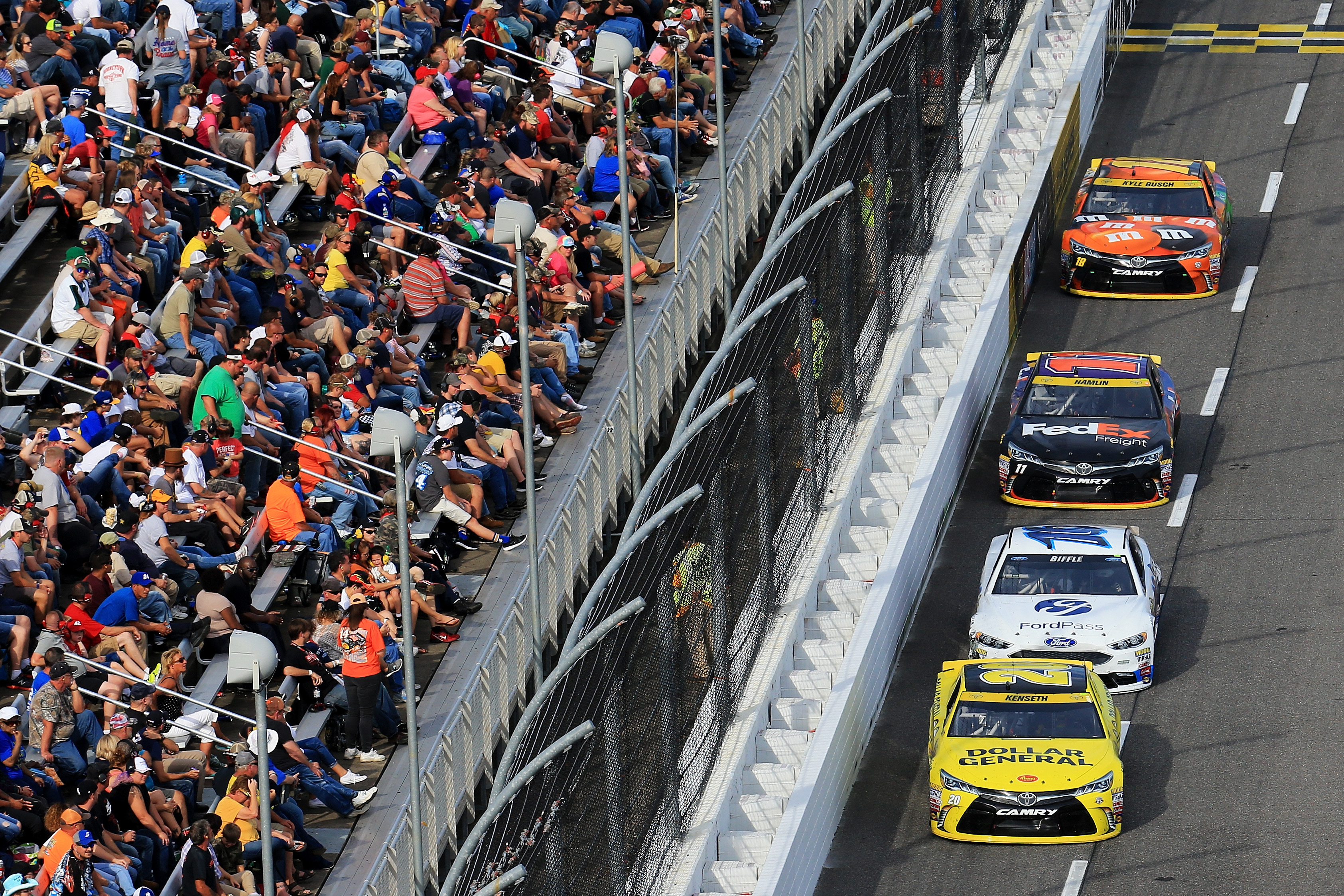 A pack of cars race during the NASCAR Sprint Cup Series Goody's Fast Relief 500 on October 30, 2016 in Martinsville, Virginia.