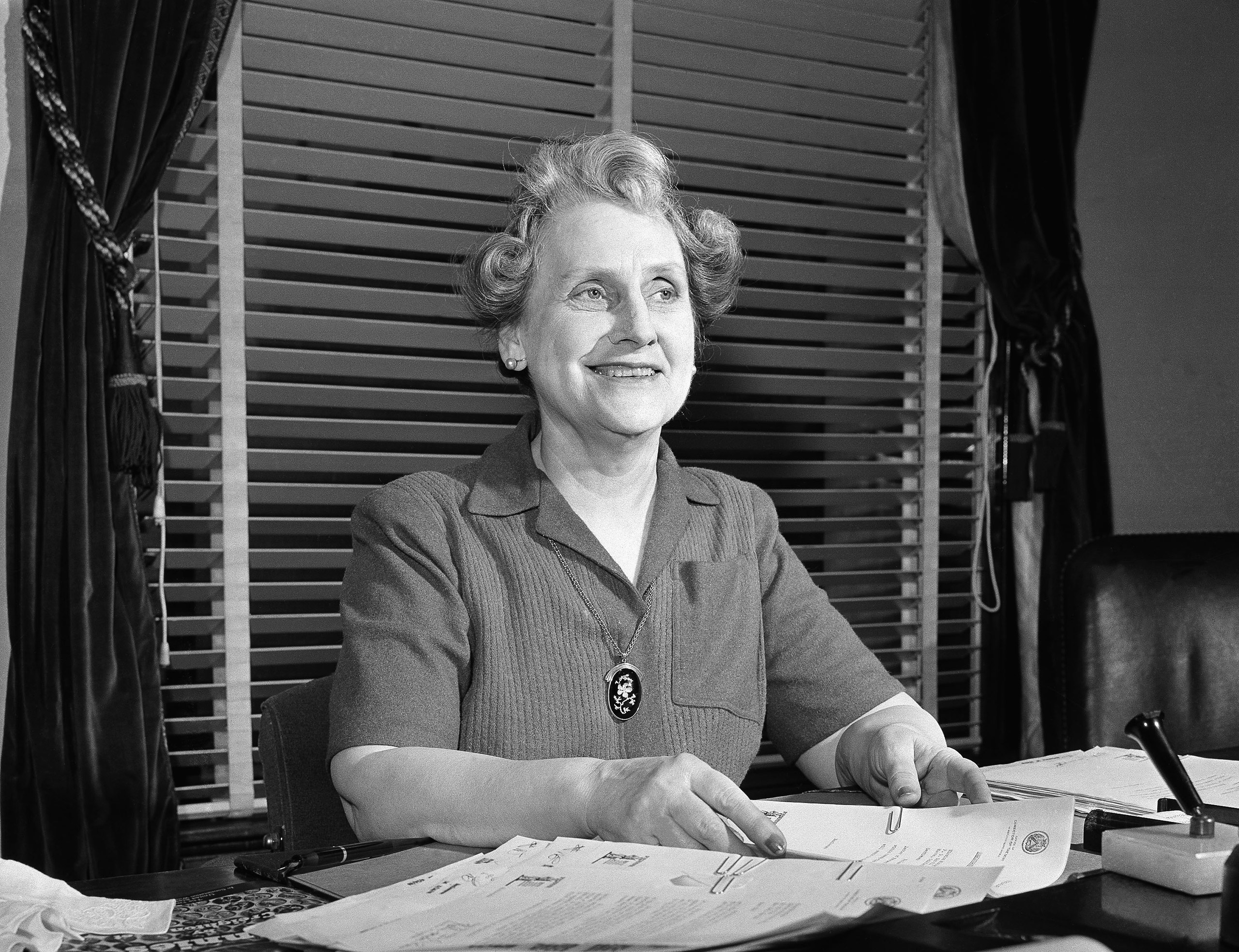 Nellie Tayloe Ross Director of the bureau of the Mint at her desk on May 1, 1942 in Washington where she supervises the turning out of the billions of coins needed for the defense effort.