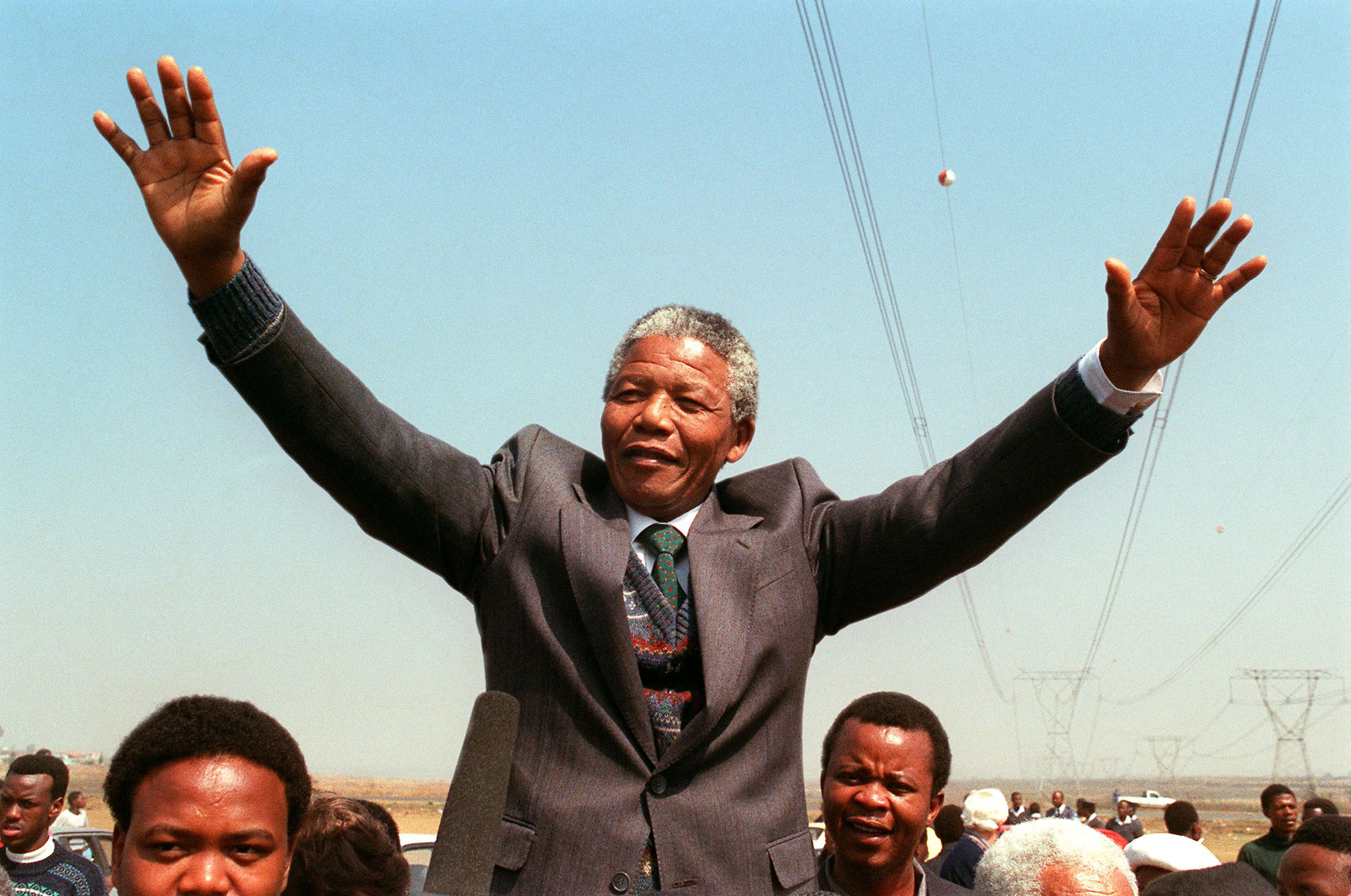 South African National Congress President Nelson Mandela addresses a crowd of residents from the Phola park squatter camp in Tokoza during his tour of townships. Sept. 5, 1990.