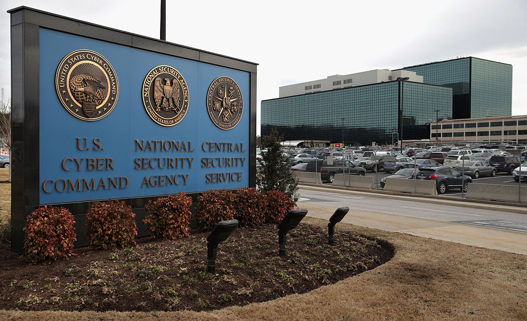 The seals of the U.S. Cyber Command, the National Security Agency and the Central Security Service greet employees and visitors at the campus the three organizations share on March 13, 2015 in Fort Meade, Maryland.