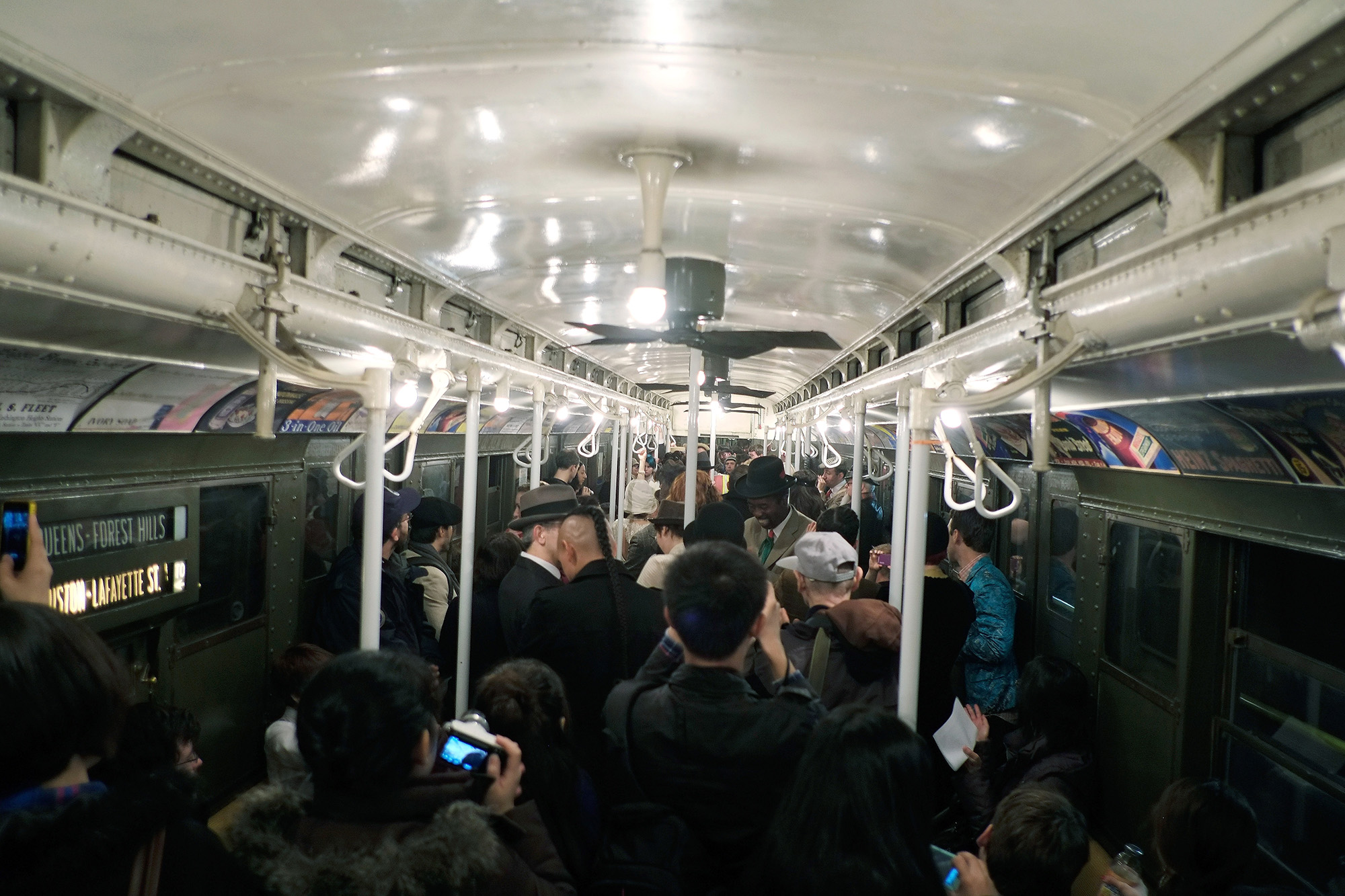 People crowd into a vintage New York City subway car as people dance to a live band on December 16, 2012 in New York City. The New York Metropolitan Transportation Authority (MTA) runs vintage subway trains from the 1930's-1970's each Sunday along the M train route from Manhattan to Queens through the first of the year.  (Photo by Preston Rescigno/Getty Images)