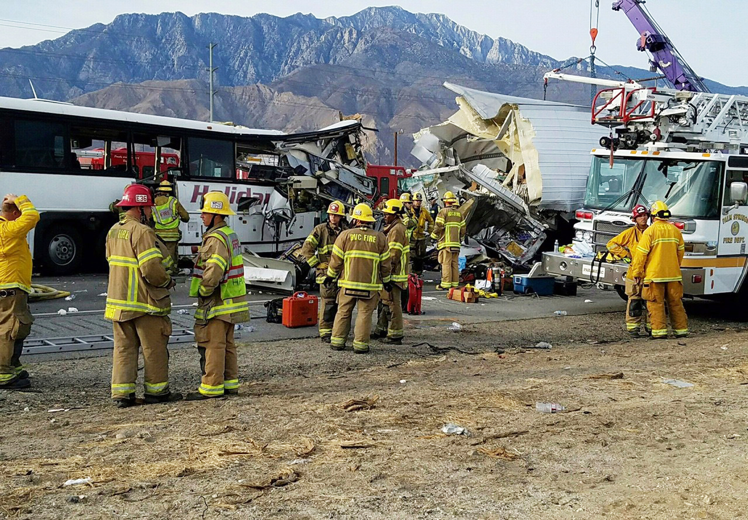 The scene of crash between a tour bus and a semi-truck crashed on Interstate 10 near Desert Hot Springs, near Palm Springs, Calif., on Oct. 23, 2016.