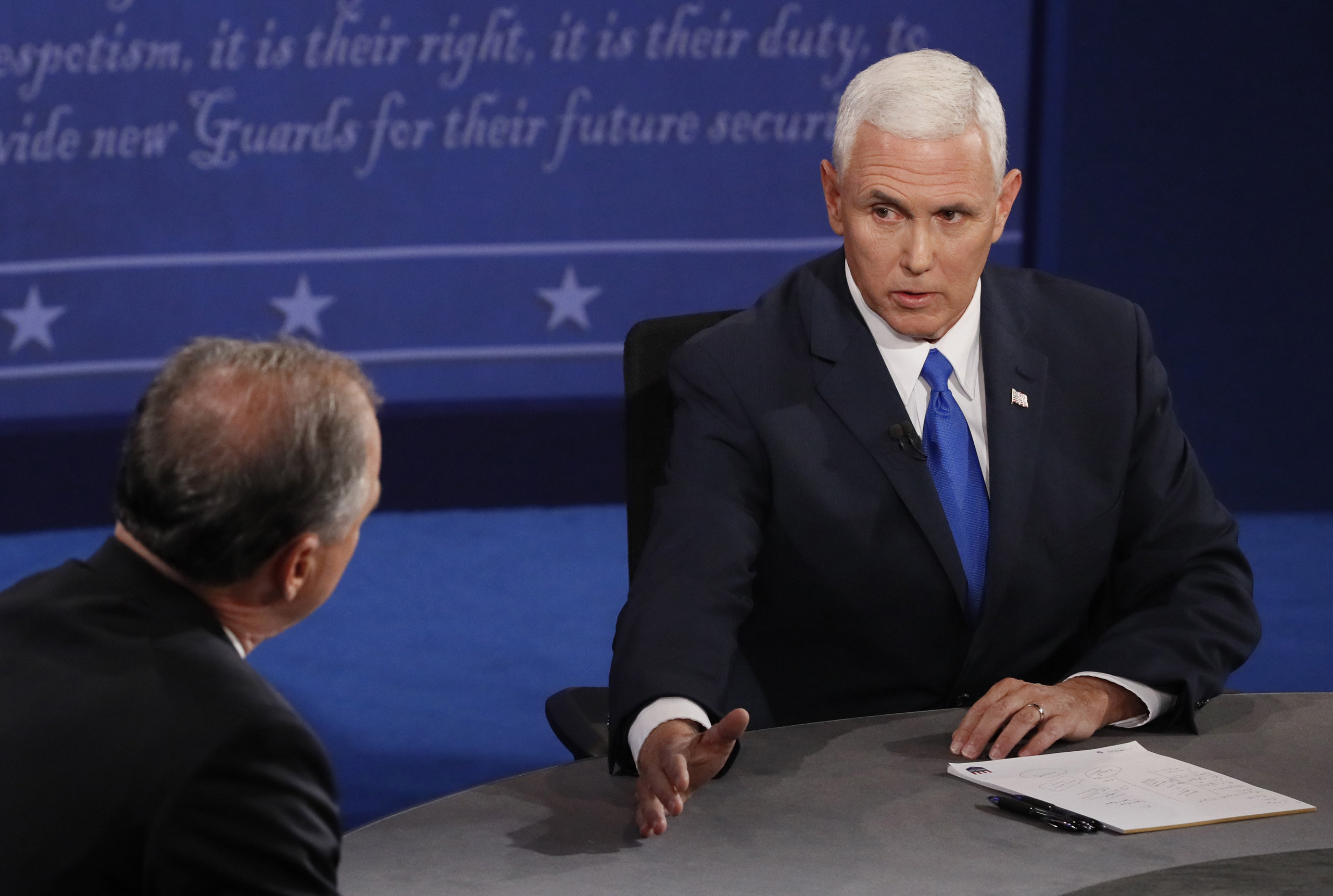 Democratic candidate for Vice President Tim Kaine (L) exchanges with Republican candidate for Vice President Mike Pence (R) during the first vice presidential debate at Longwood University in Farmville, Virginia, on Oct. 4, 2016.
