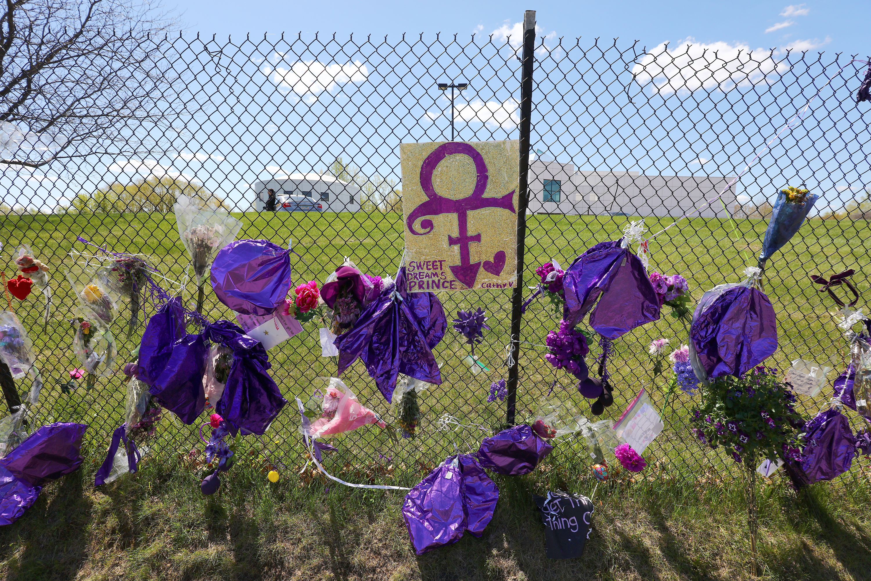 Tributes and memorials dedicated to Prince on the fence that surrounds Paisley Park on May 2, 2016 in Chaska, Minnesota.