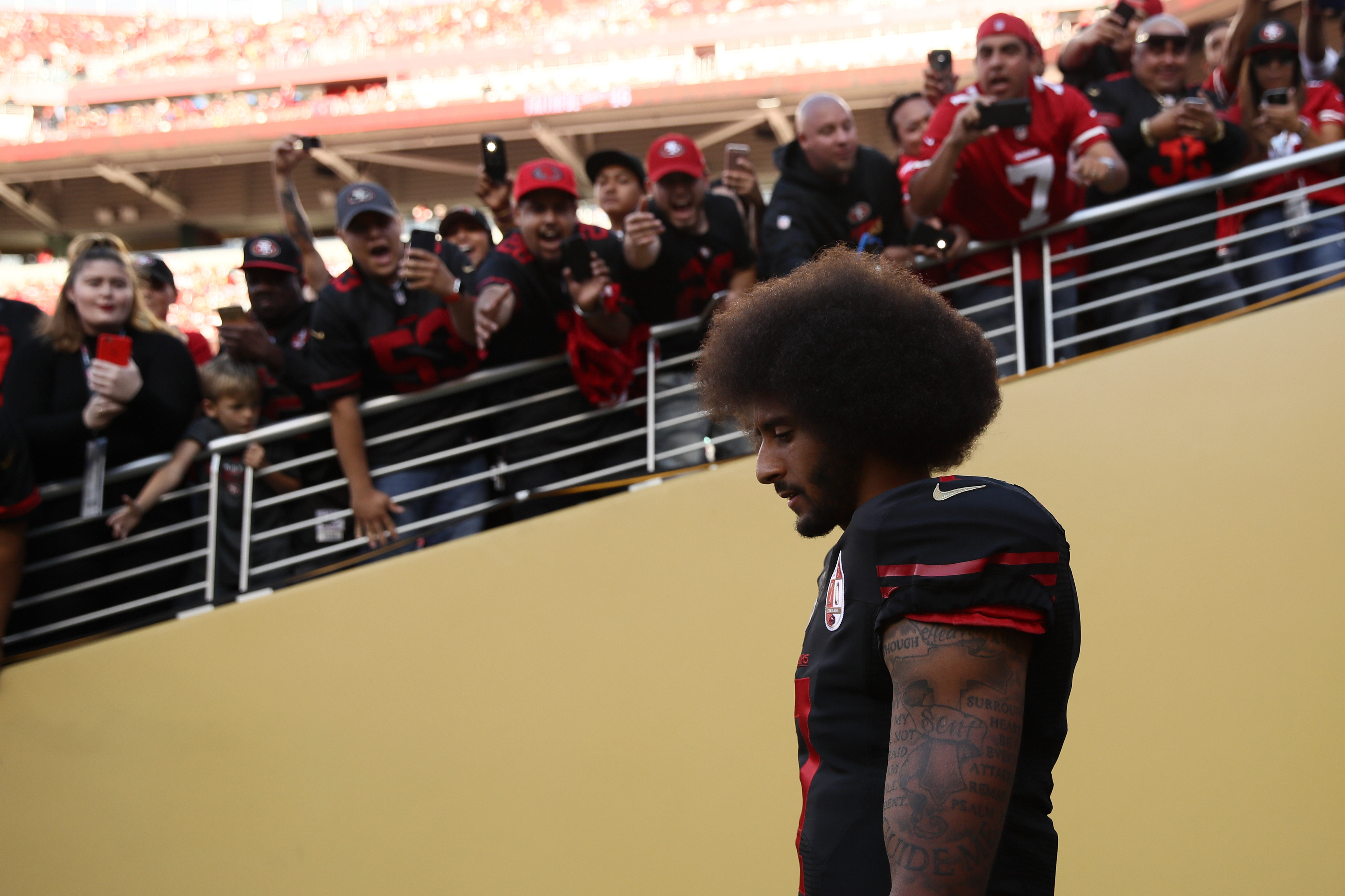 Colin Kaepernick, quarterback for the San Francisco 49ers, walks on the field prior to the team's NFL game on October 6, 2016.