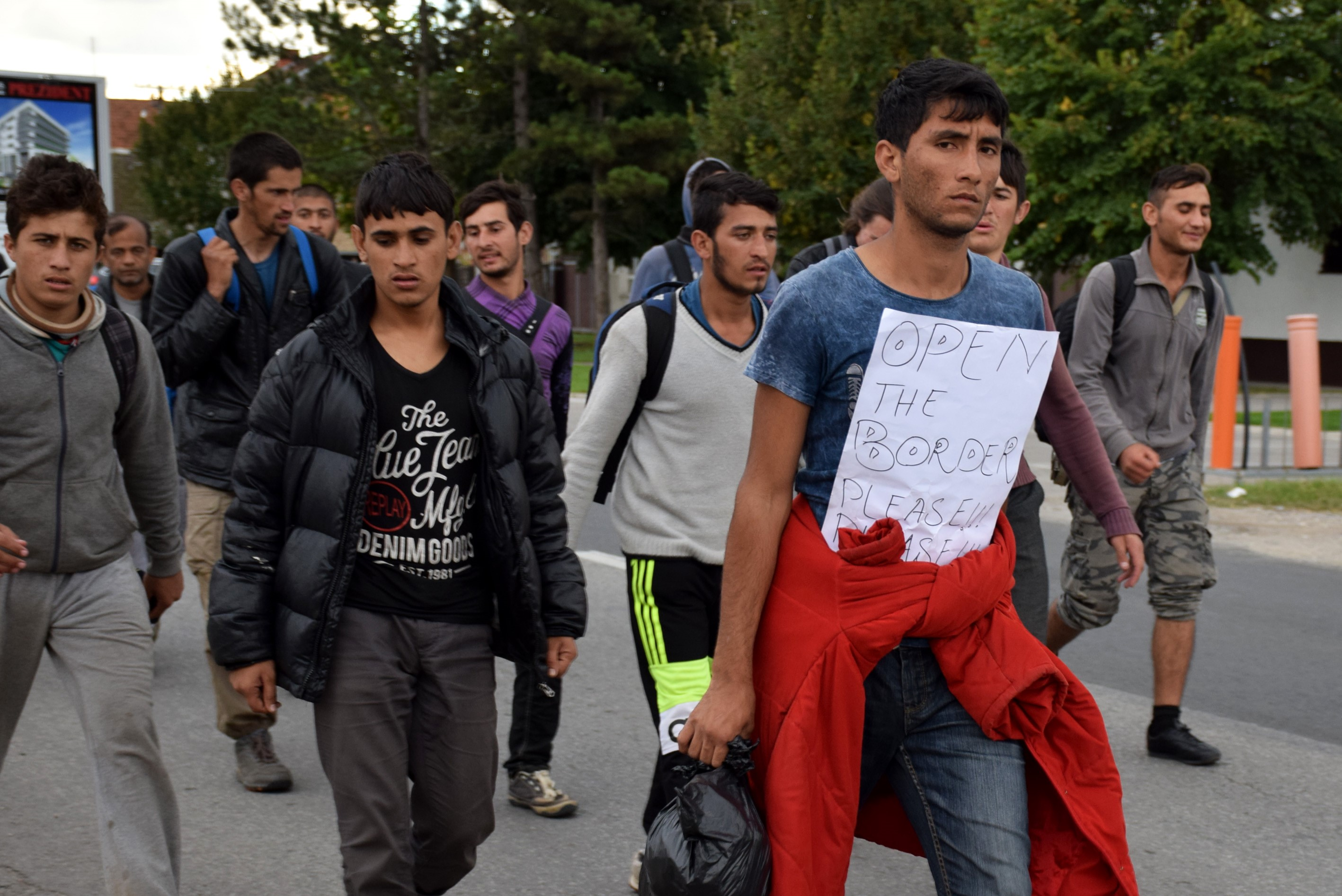 Refugees make their way to Hungarian border with Serbia near the town of Horgos in Belgrade, Serbia on Oct. 4, 2016.