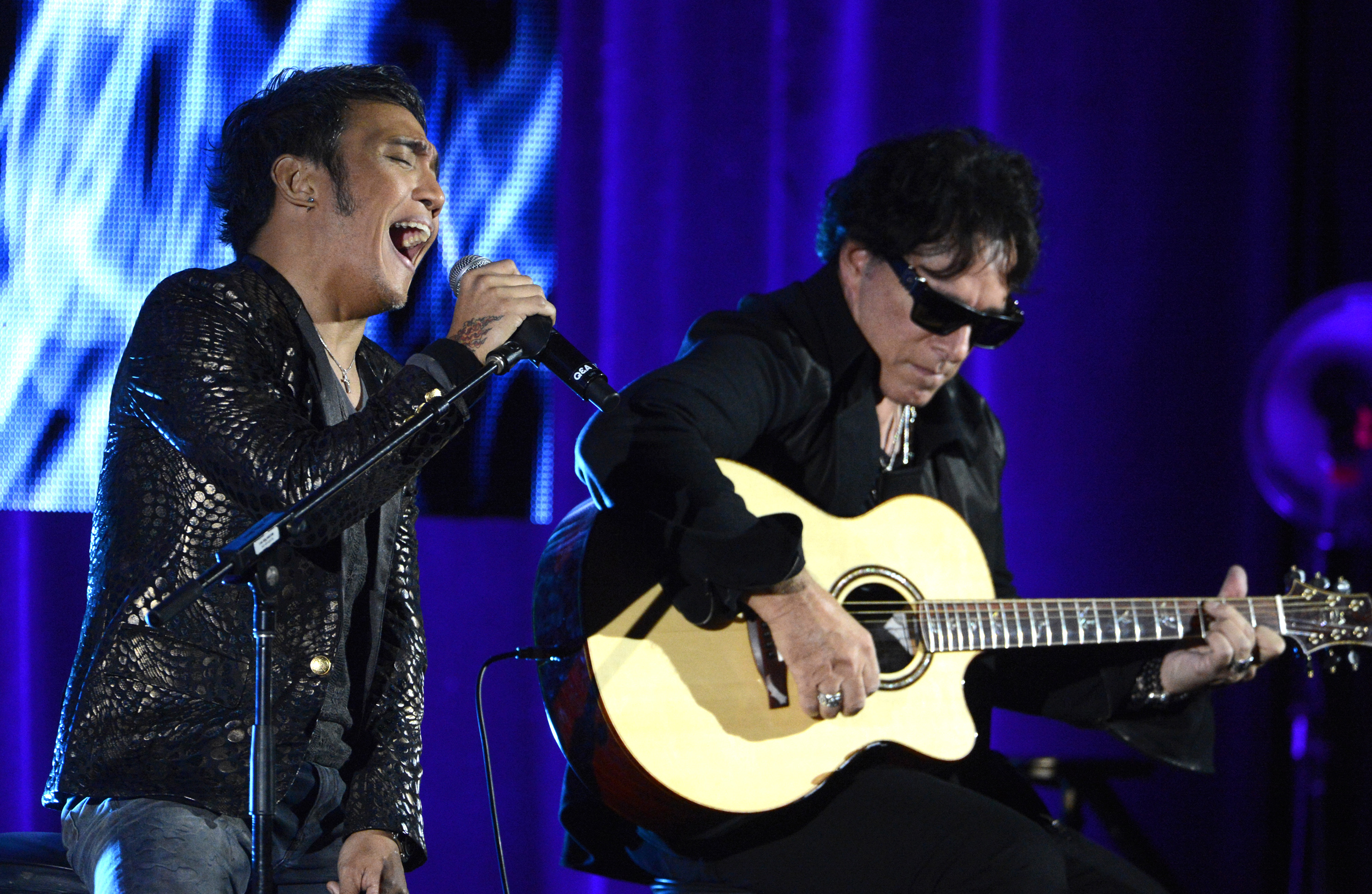 Arnel Pineda, left, and Neal Schon of rock band Journey perform during the PBS sessions at the Television Critics Association summer press tour in Beverly Hills, Calif., on August 6, 2013