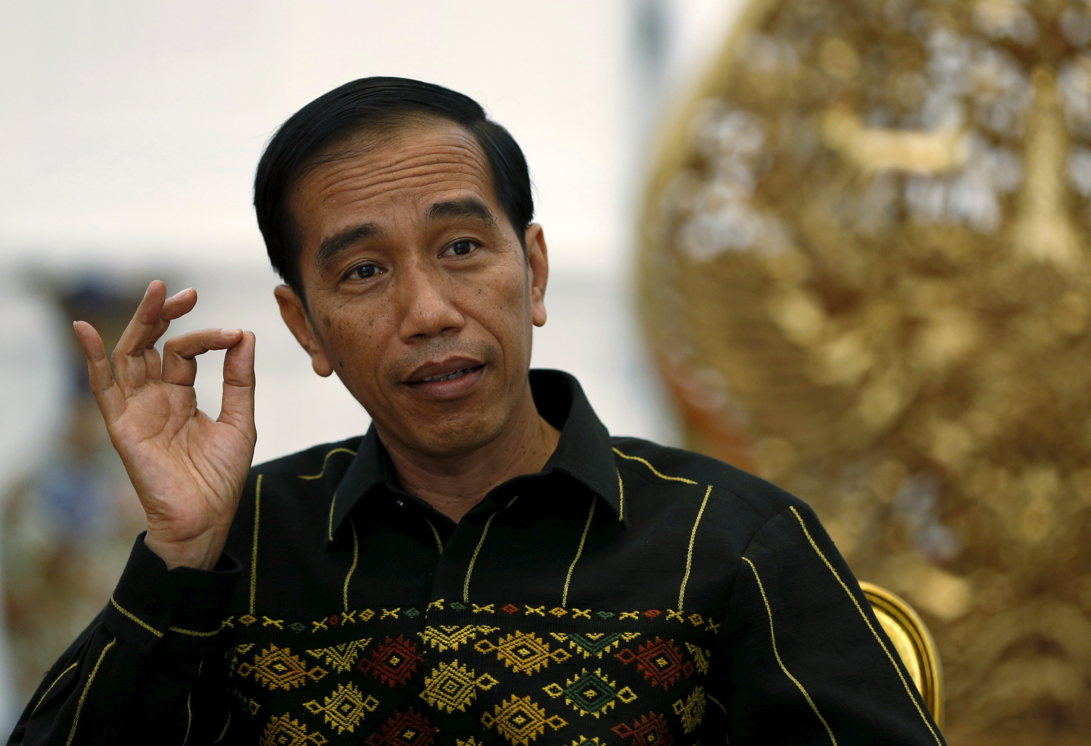 Indonesian President Joko Widodo gestures during an interview with Reuters at the presidential palace in Jakarta on Feb. 10, 2016