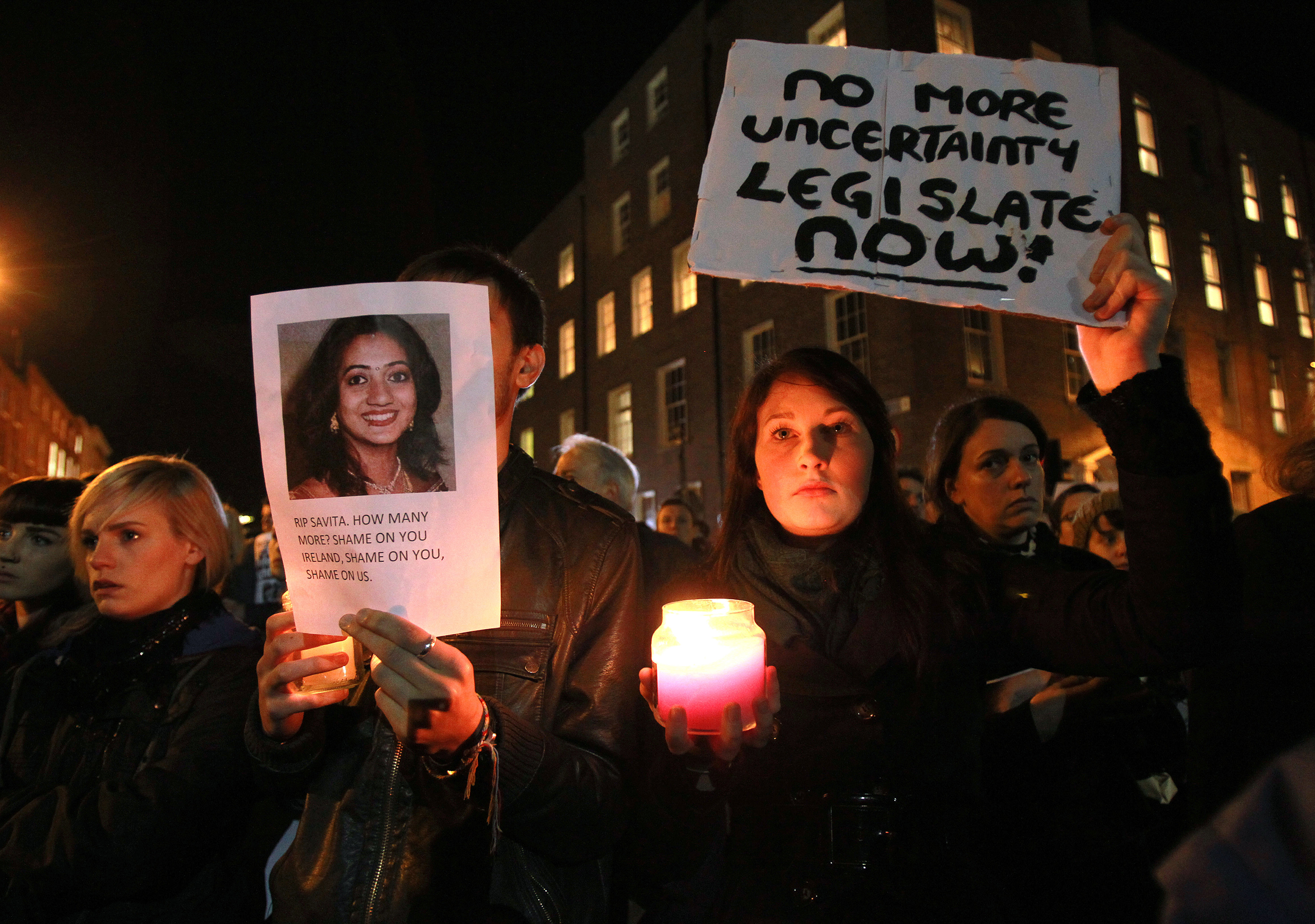 Protestors hold pictures of Savita Halappanavar, an Indian woman who was allegedly refused a pregnancy termination after doctors told her it was a Catholic country, as they gather outside the Parliament building during a demonstration in favor of abortion legislation in Dublin on Nov. 14, 2012.