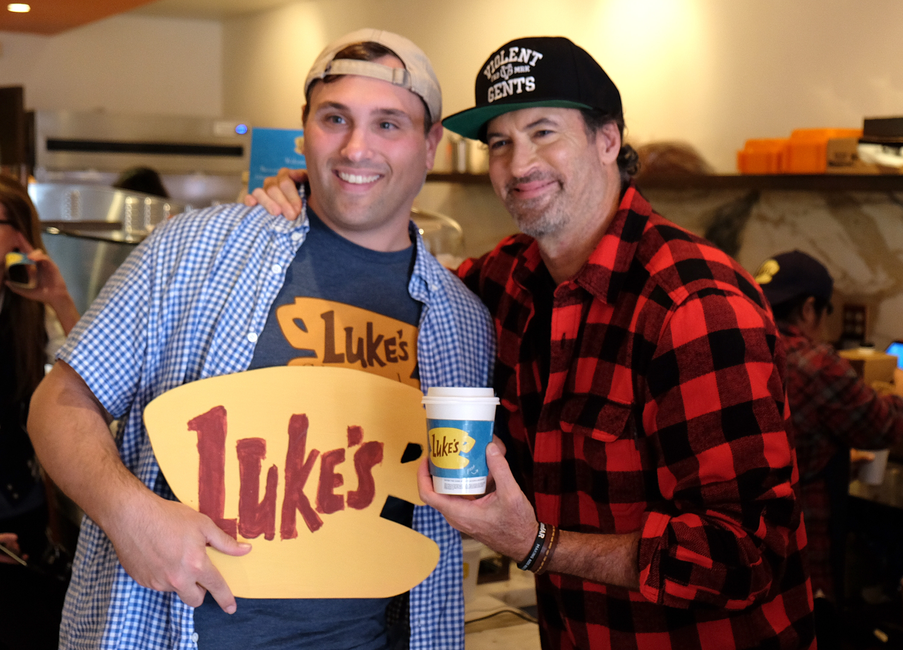 Actor Scott Patterson poses with a fan at a  Gilmore Girls  themed pop-up of Luke's Diner on October 5, 2016 in Beverly Hills, California.
