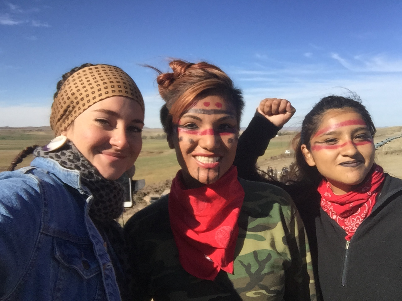 Actress Shailene Woodley (left) standing with two other people protesting the North Dakota Access Pipeline on Oct. 10, 2016.