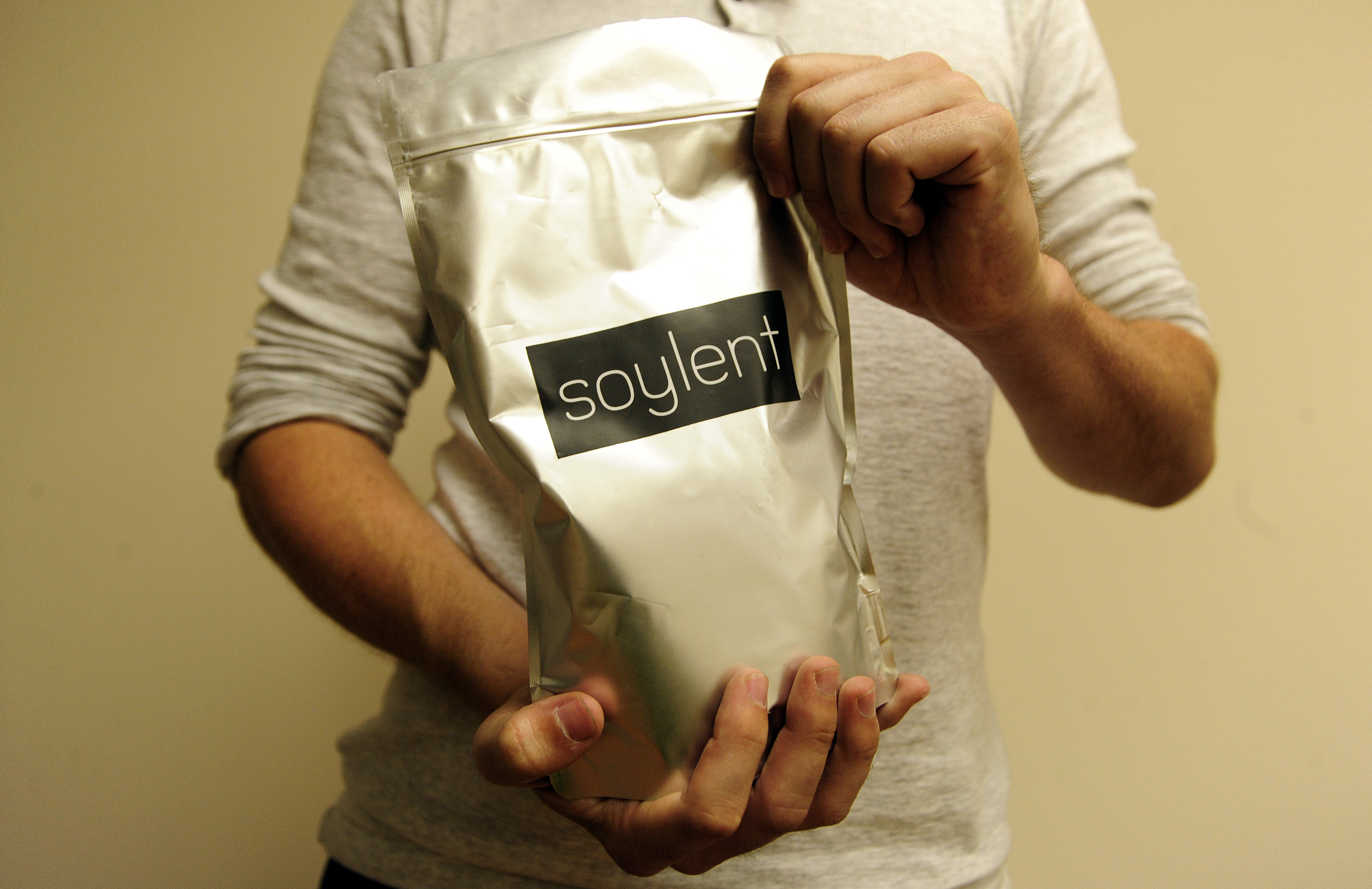 Soylent CEO Rob Rhinehart holds a bag of finished product inside a warehouse in Oakland, California where the company runs its business on September 09, 2013.