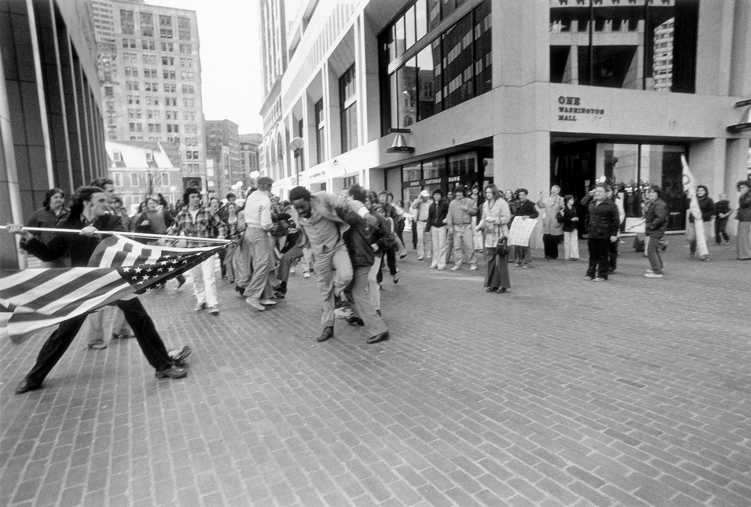 A white teenager, Joseph Rakes, is seen about to assault black lawyer and civil-rights activist Ted Landsmark with a flagpole bearing the American flag in Boston, April 5, 1976.