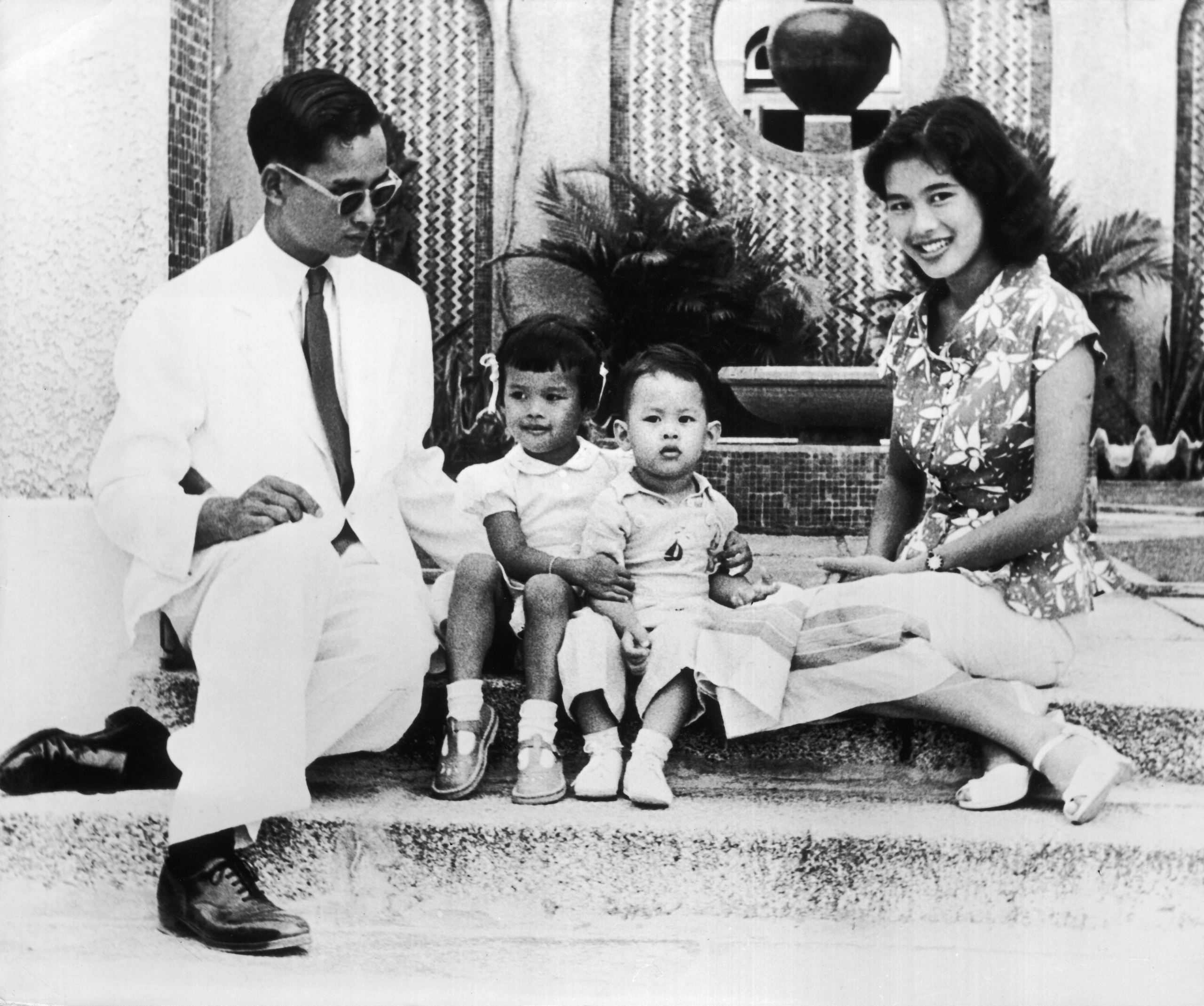 King Bhumibol Adulyadej with his wife Queen Sirikit and their children Crown Prince Maha Vajiralongkorn (right) and Princess Ubolratana Rajakanya in 1954.