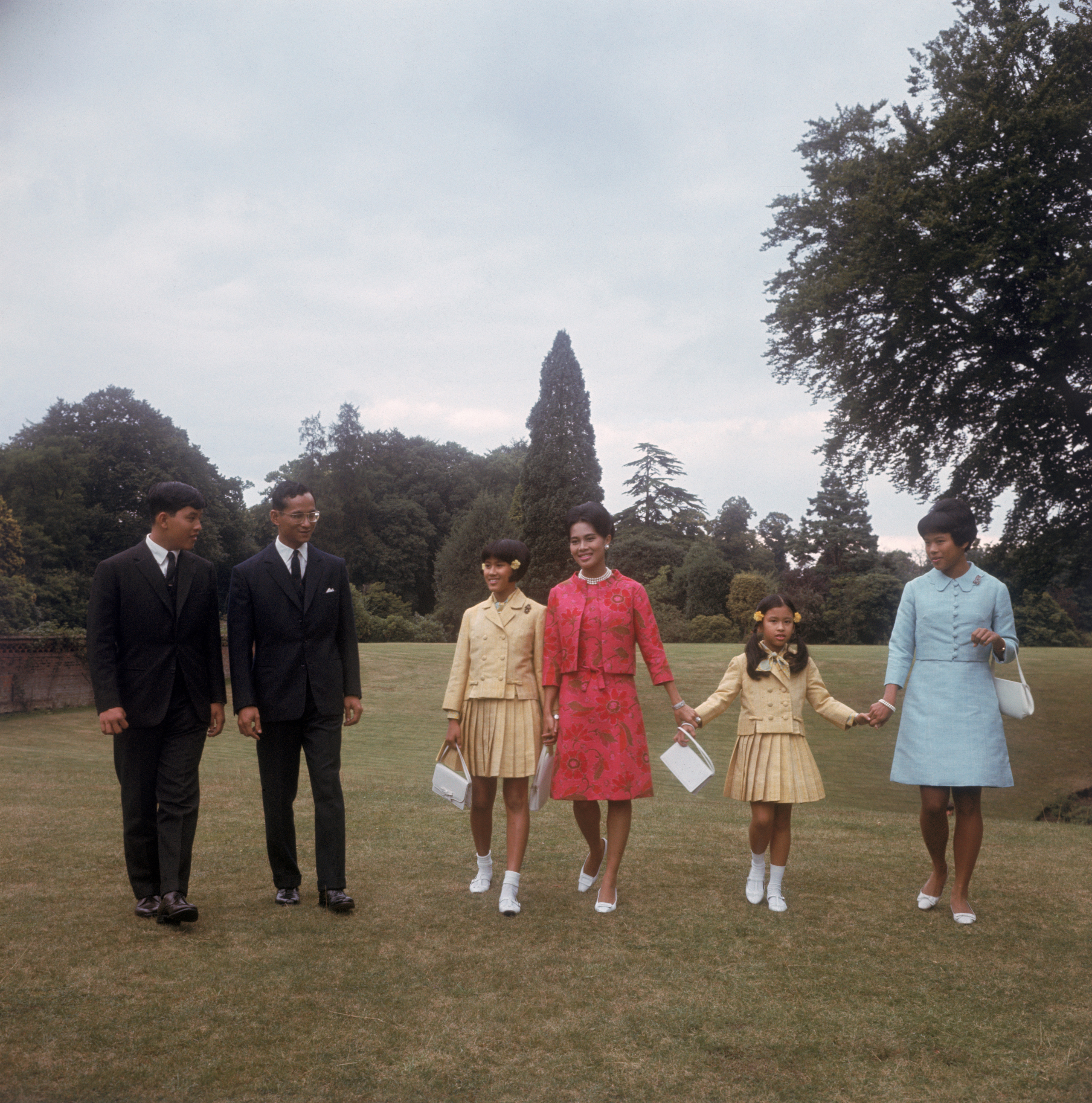 King Bhumibol Adulyadej and Queen Sirikit  with their children at King's Beeches, their private residence in Sunninghill, Berkshire, July 27, 1966.