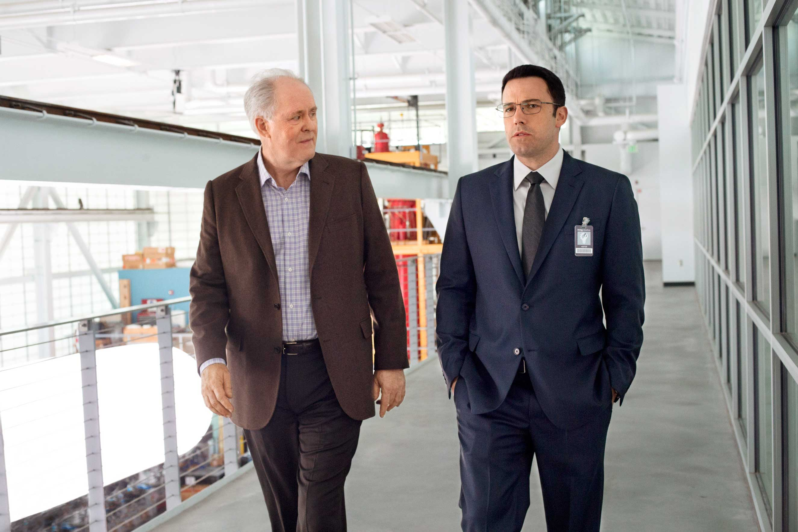 Lithgow and Affleck do their best to make talking about numbers look interesting