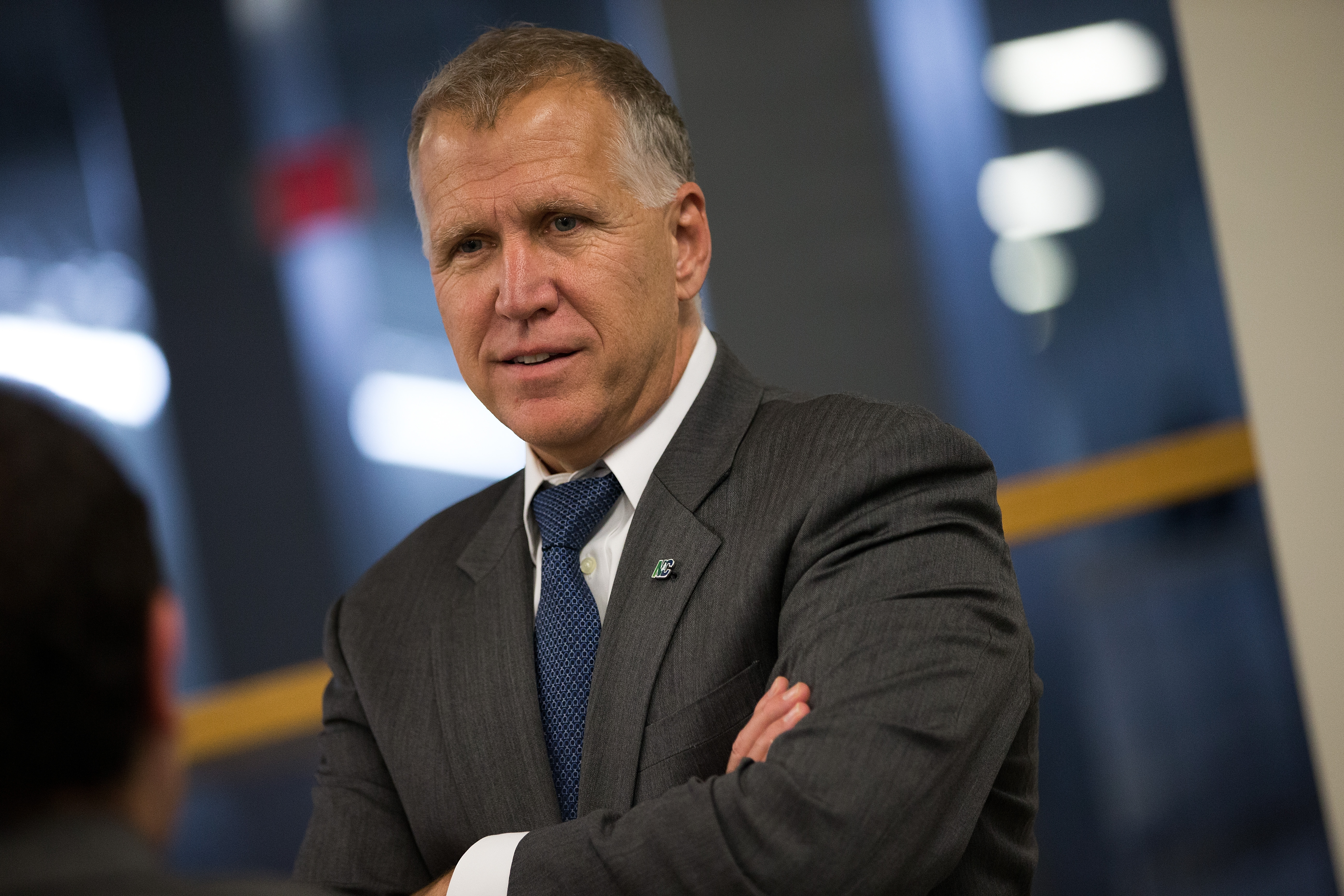 Sen. Thom Tillis speaks with an aide after a vote at the U.S. Capitol in Washington, D.C., on May 9, 2016.