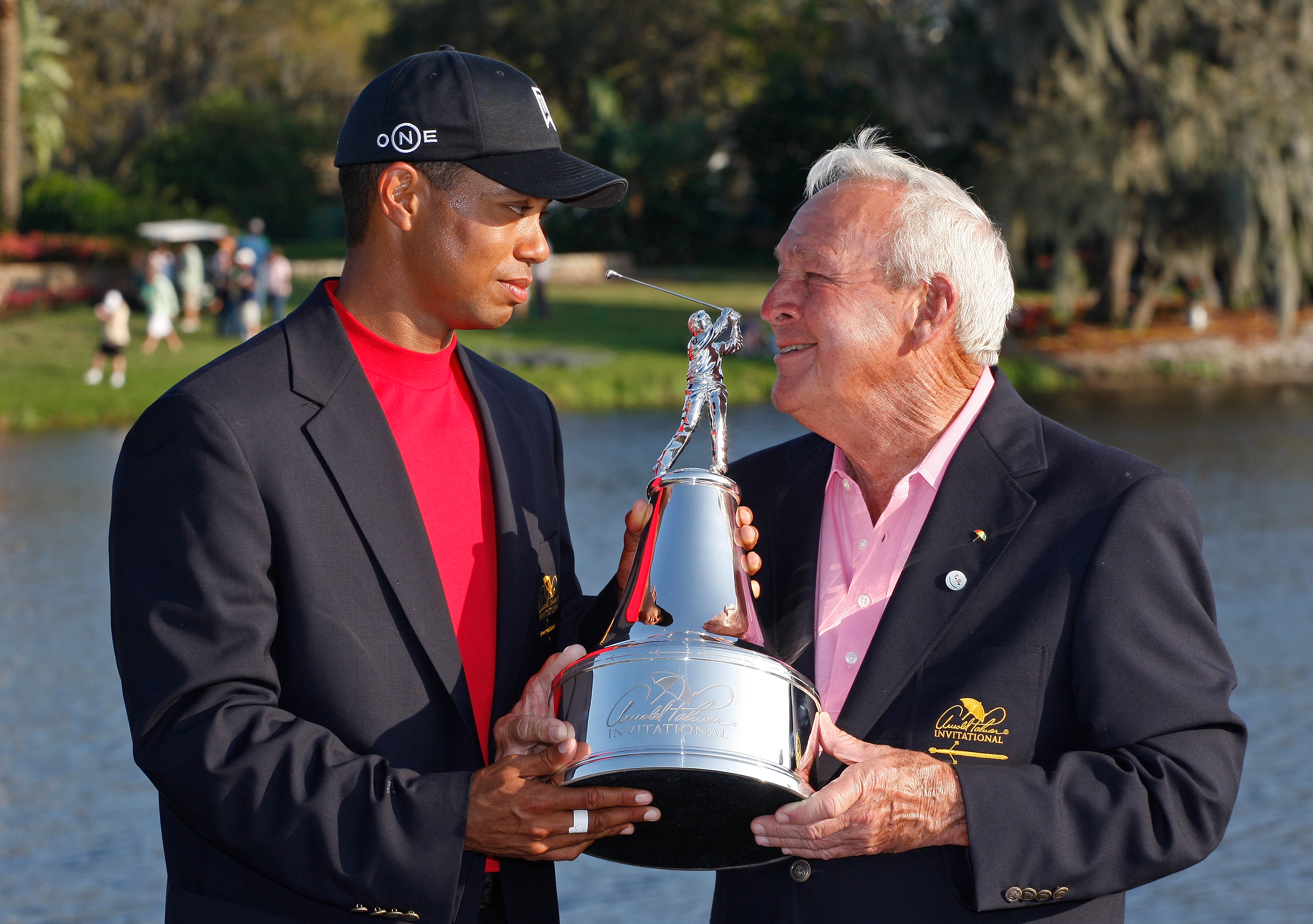 Tiger Woods poses with the winners trophy and Arnold Palmer after his victory in the Arnold Palmer Invitational presented by MasterCard held on March 16, 2008 at Bay Hill Golf Club and Lodge in Orlando, Florida.
