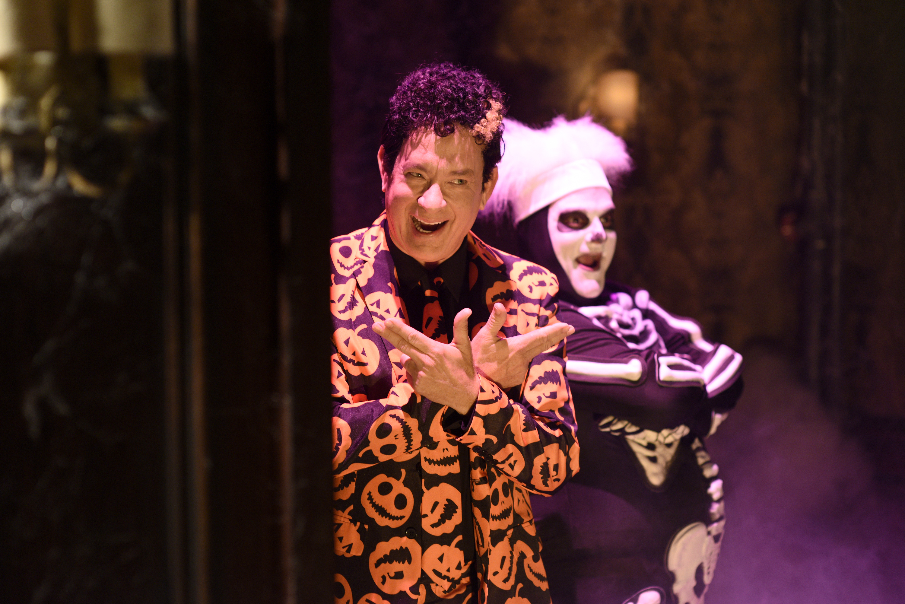 Tom Hanks  Episode 1708 -- Pictured: (l-r) Tom Hanks as David Pumpkins and Bobby Moynihan during the  Haunted Elevator  sketch on October 22, 2016.
