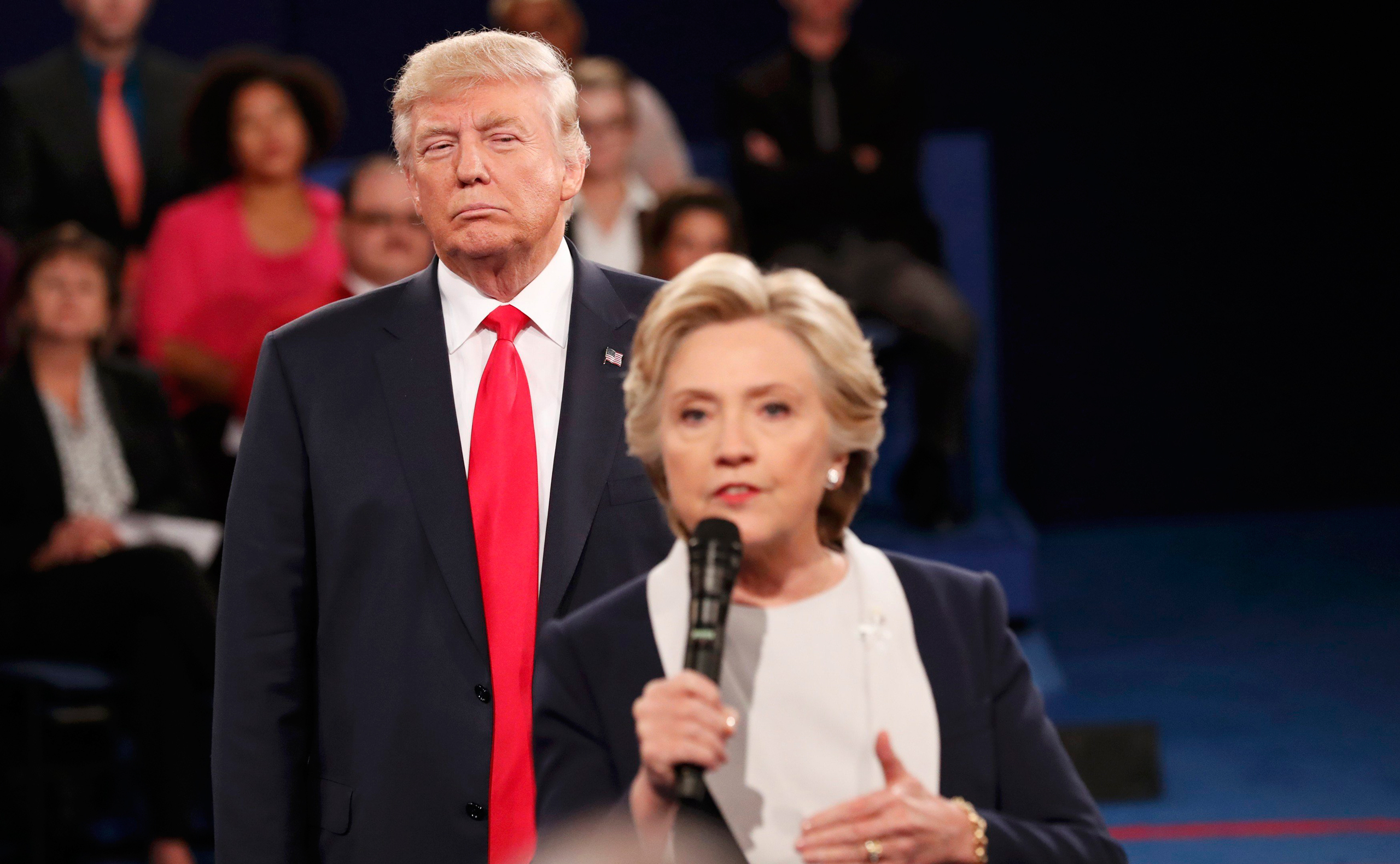 Republican presidential nominee Donald Trump listens as Democratic nominee Hillary Clinton answers a question from the audience during the second presidential debate at Washington University in St. Louis on Oct. 9, 2016.