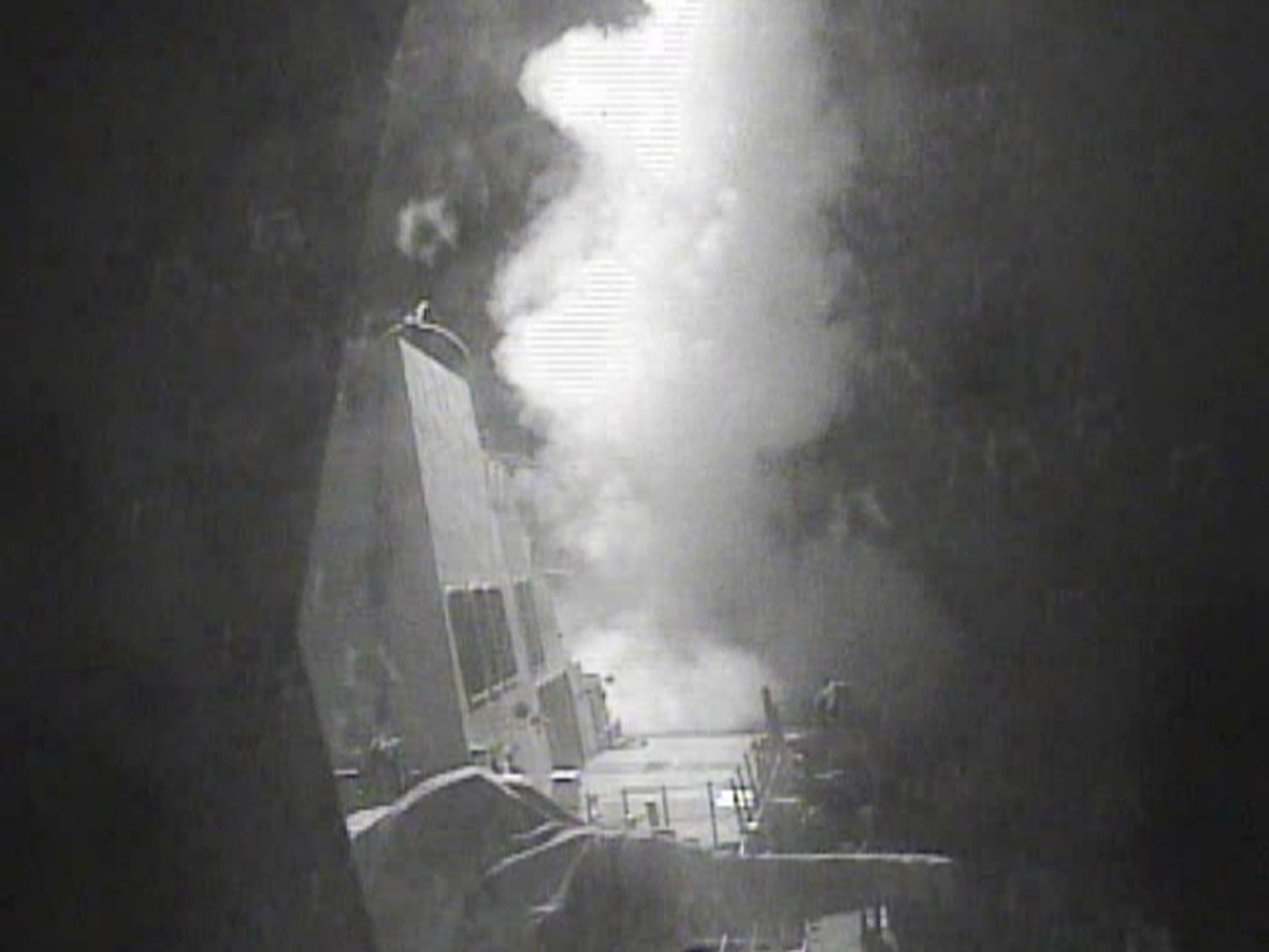 The guided missile destroyer USS Nitze (DDG 94) launches a strike against coastal sites in Houthi-controlled territory on Yemen's Red Sea coast on Oct. 13, 2016.