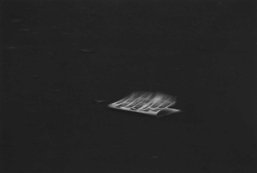 windblown-headline-on-a-dark-pavement-nyc-1956