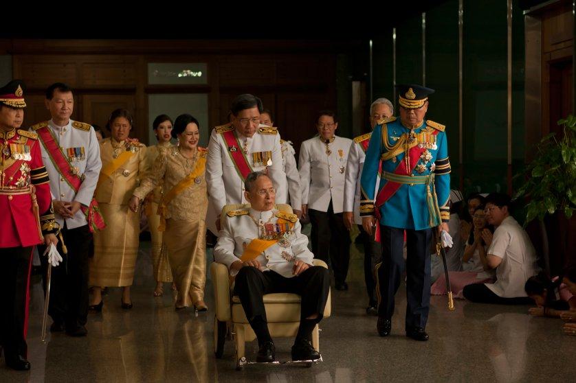 King Bhumibol Adulyadej leaves the Siriraj Hospital for a birthday ceremony at the Grand Palace, Bangkok, Thailand, Dec. 5, 2011.