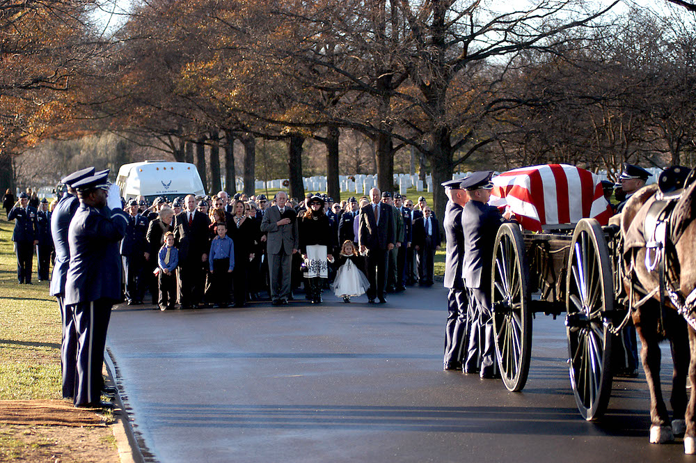 Dec. 11, 2006. The Gilbert family behind the caisson at Major Troy Gilbert's first burial at Arlington.