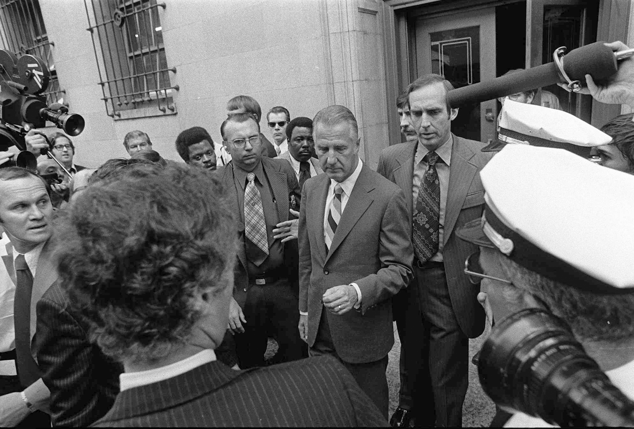 Spiro T. Agnew, center, is shown leaving court in Baltimore Oct. 10, 1973 after pleading no contest to a charge of income tax evasion.  Agnew resigned from the Vice Presidency shortly after.