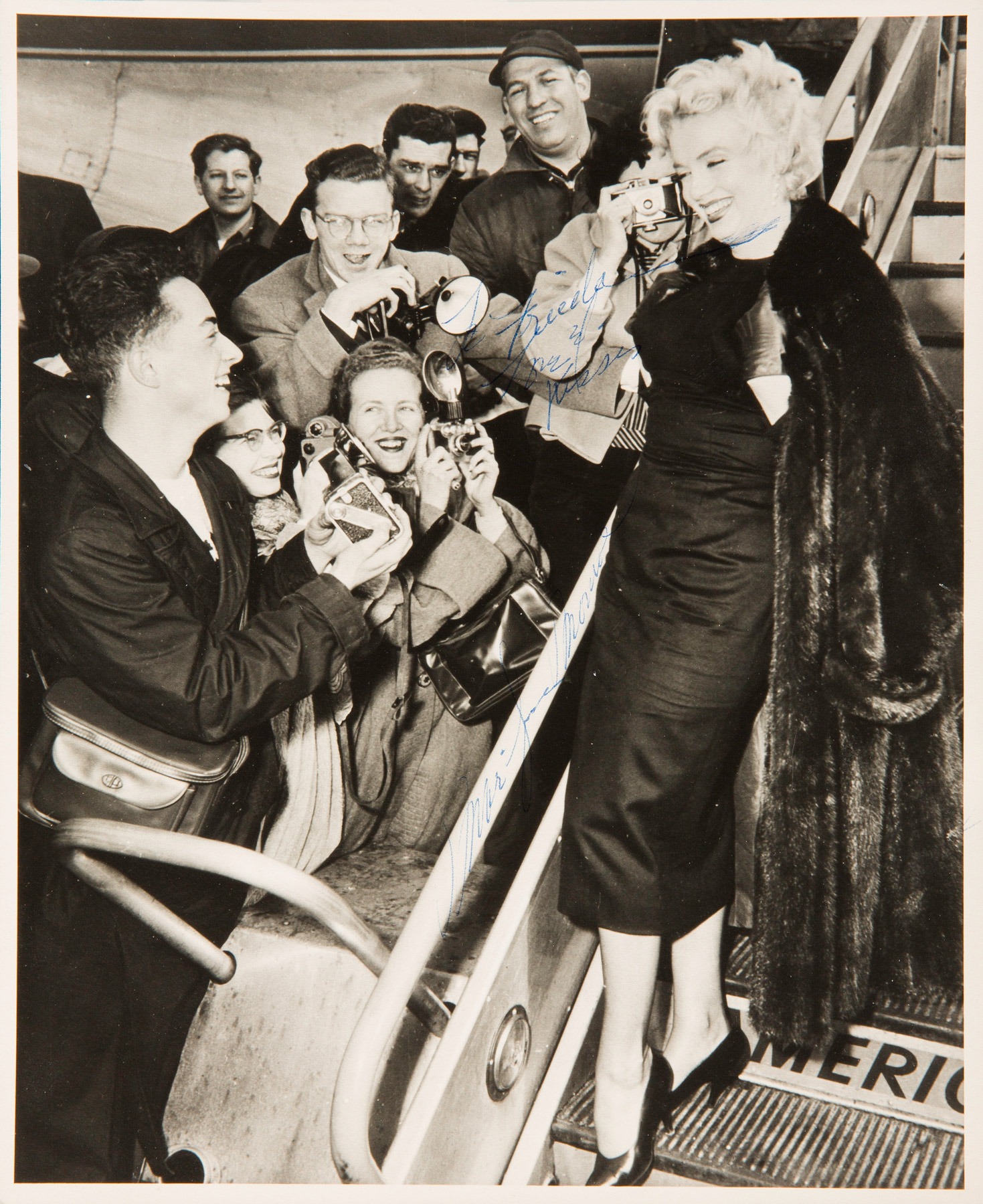 Marilyn Monroe as she boarded a plane for Hollywood at Idlewild Airport in New York on Feb. 25, 1956.