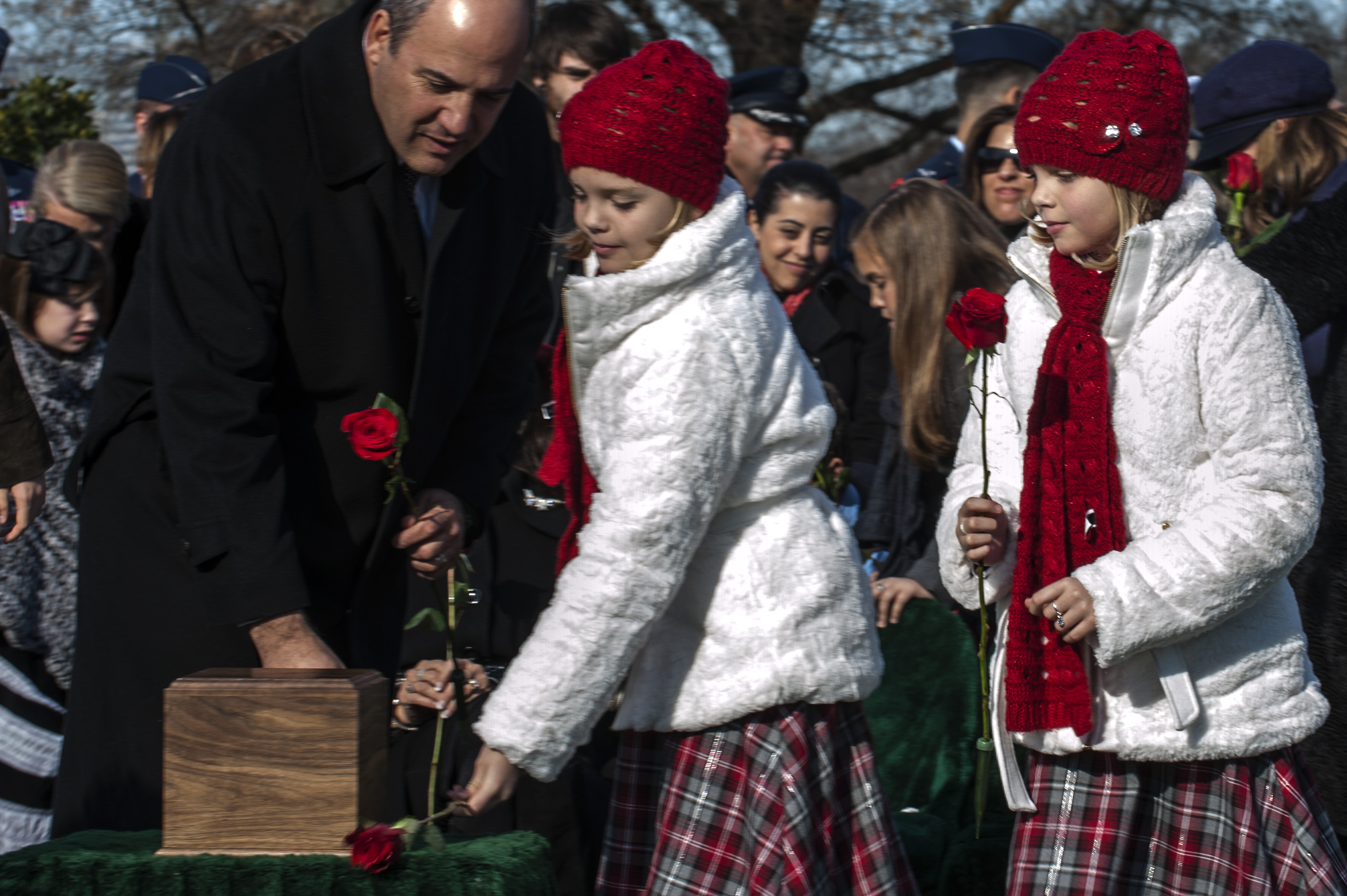 Dec. 11, 2013. Aspen and Annalise Gilbert Ravella remember their father at his second Arlington burial.