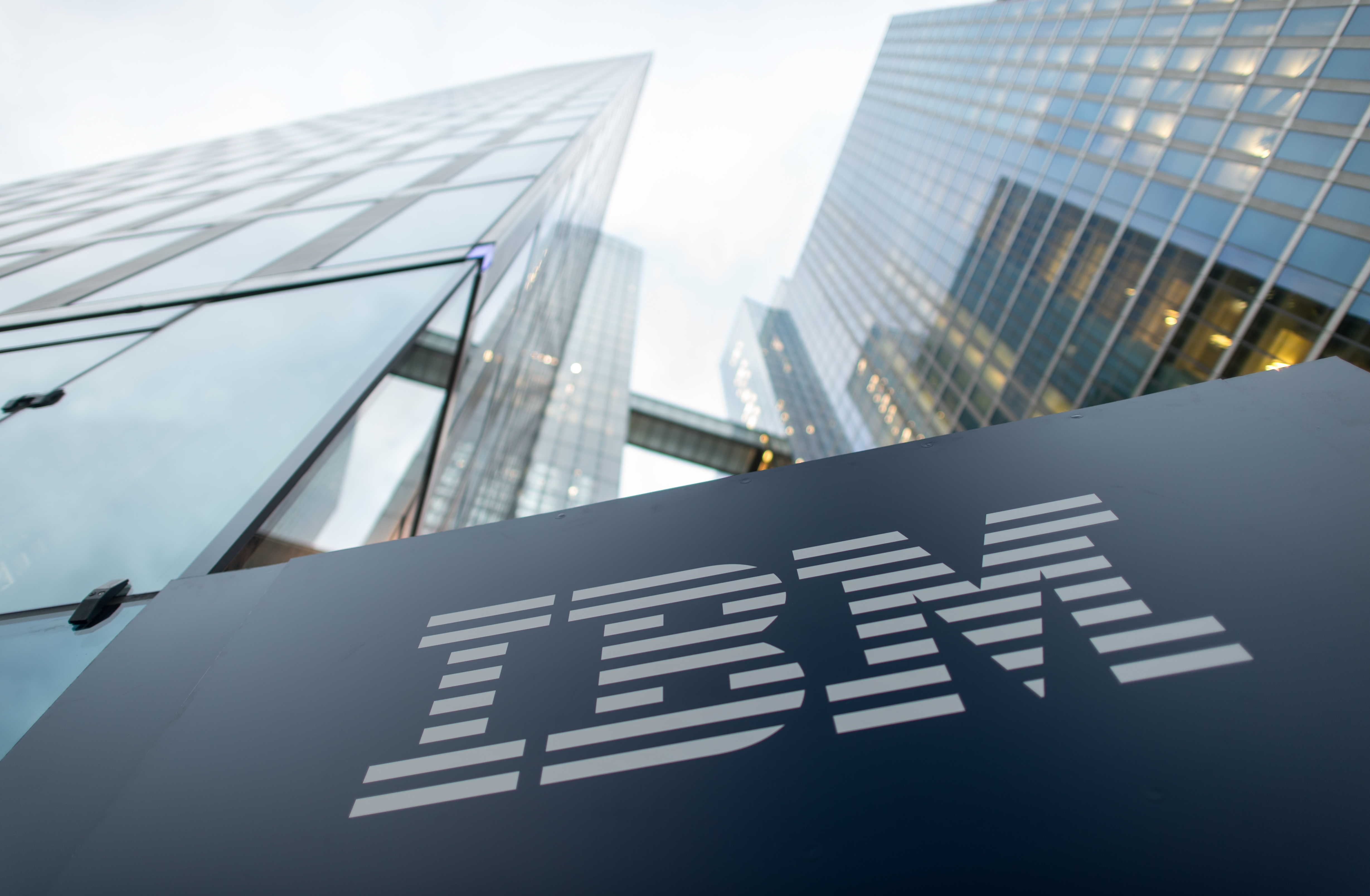 FILE - The logo of IBM is seen at the entrance to the Highlight Towers inMunich,Germany, 15 December 2015.
