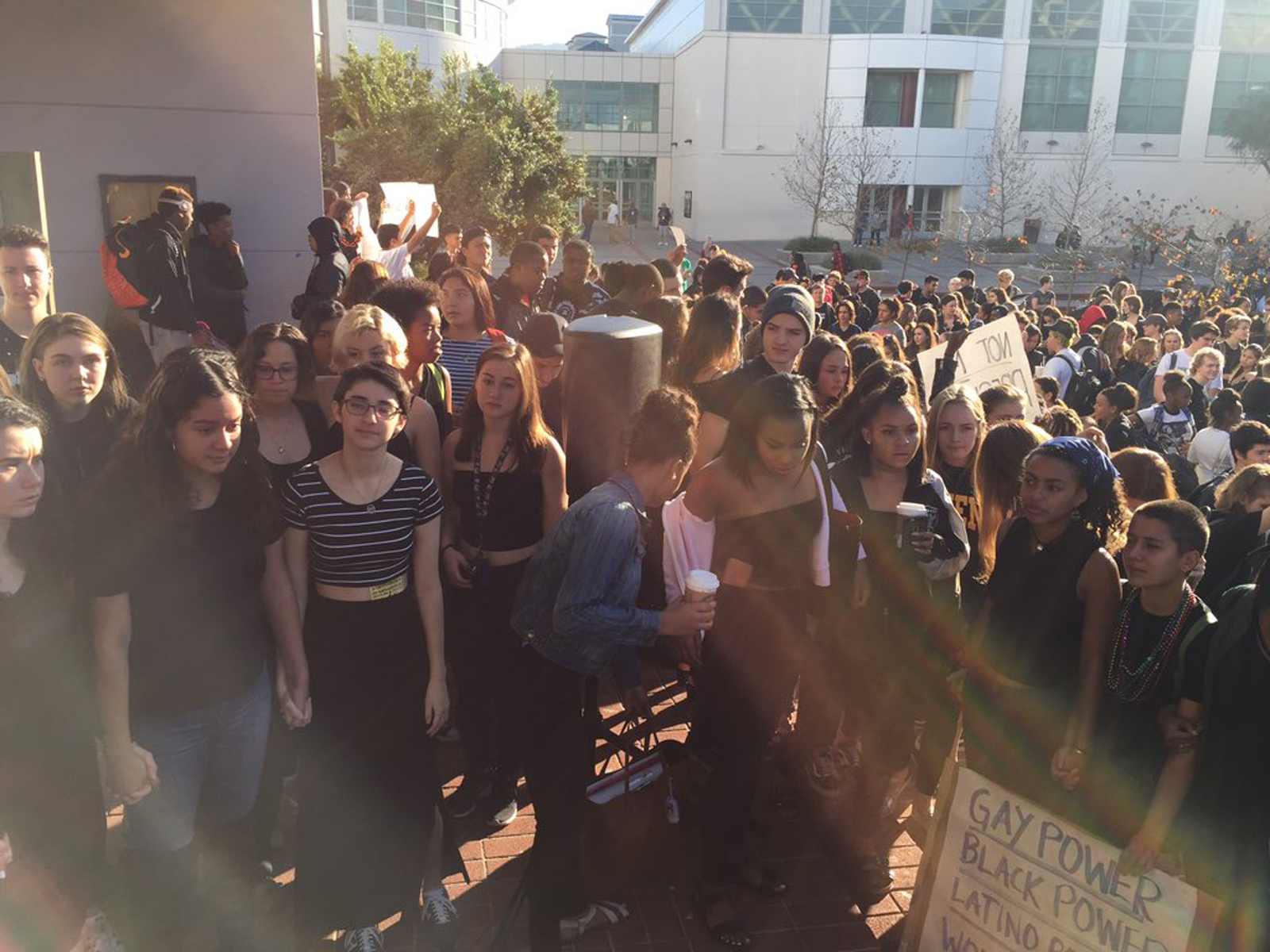 Lillian Weiner-Mock (third from left, in a striped top), co-head of the student body's Gay-Straight Alliance, stages a walk out with fellow students at Berkeley High School to protest against the presidential election of Donald Trump, in Berkeley, Calif., on Nov. 9, 2016.