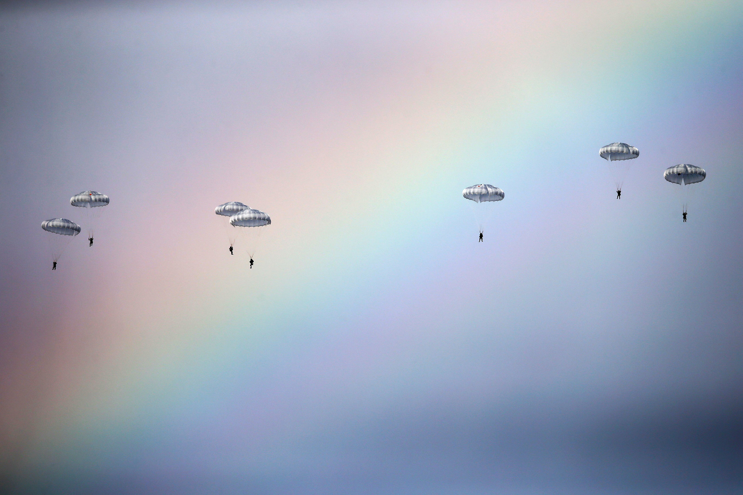Russian paratroopers jump past a rainbow from an IL-76 transport plane during a joint Serbian-Russian military training exercise  Slavic Brotherhood  in the town of Kovin, near Belgrade, Serbia, on Nov. 7, 2016.