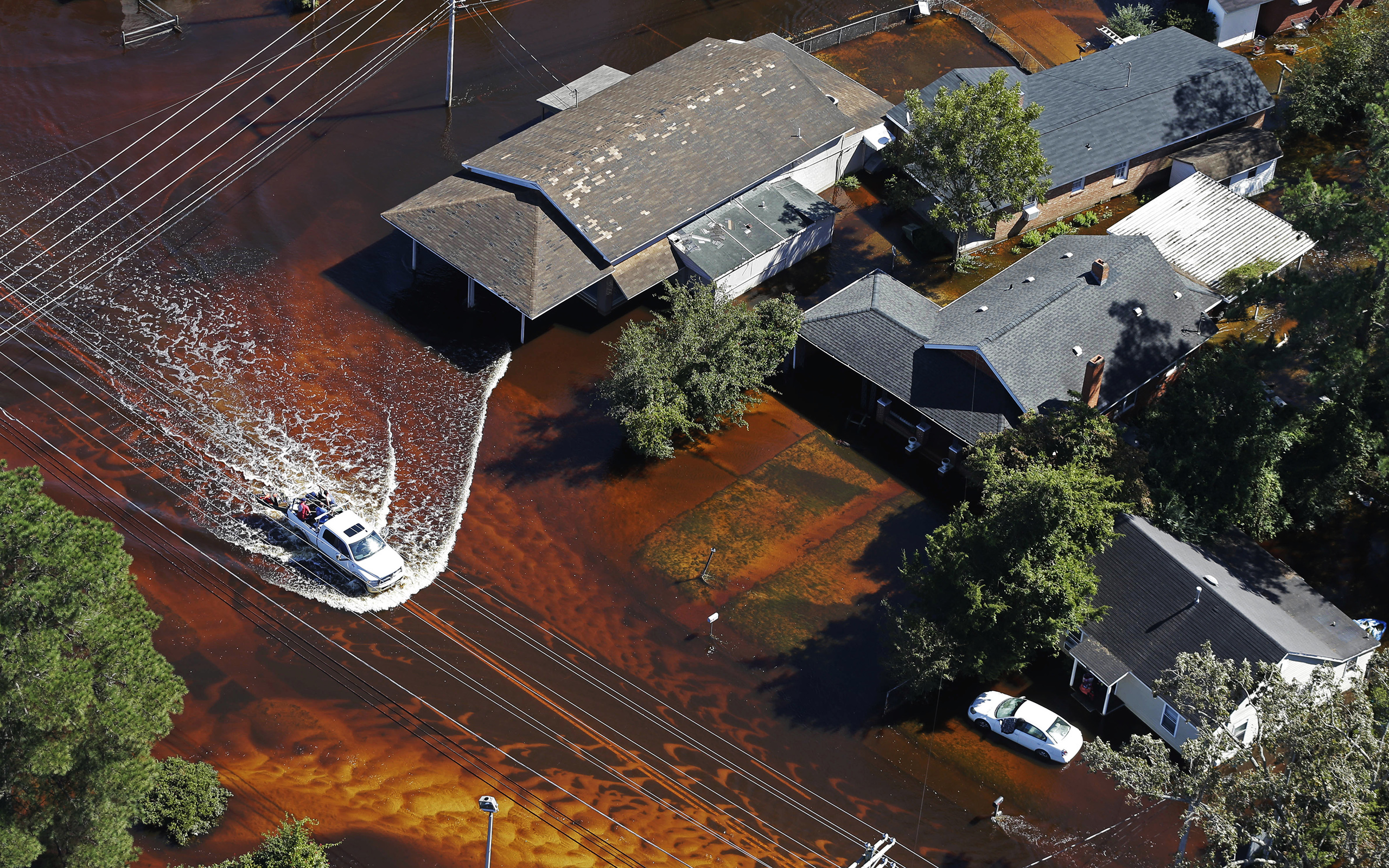 A truck drives through floodwaters from Hurricane Matthew in Lumberton, N.C., on Oct. 12, 2016.