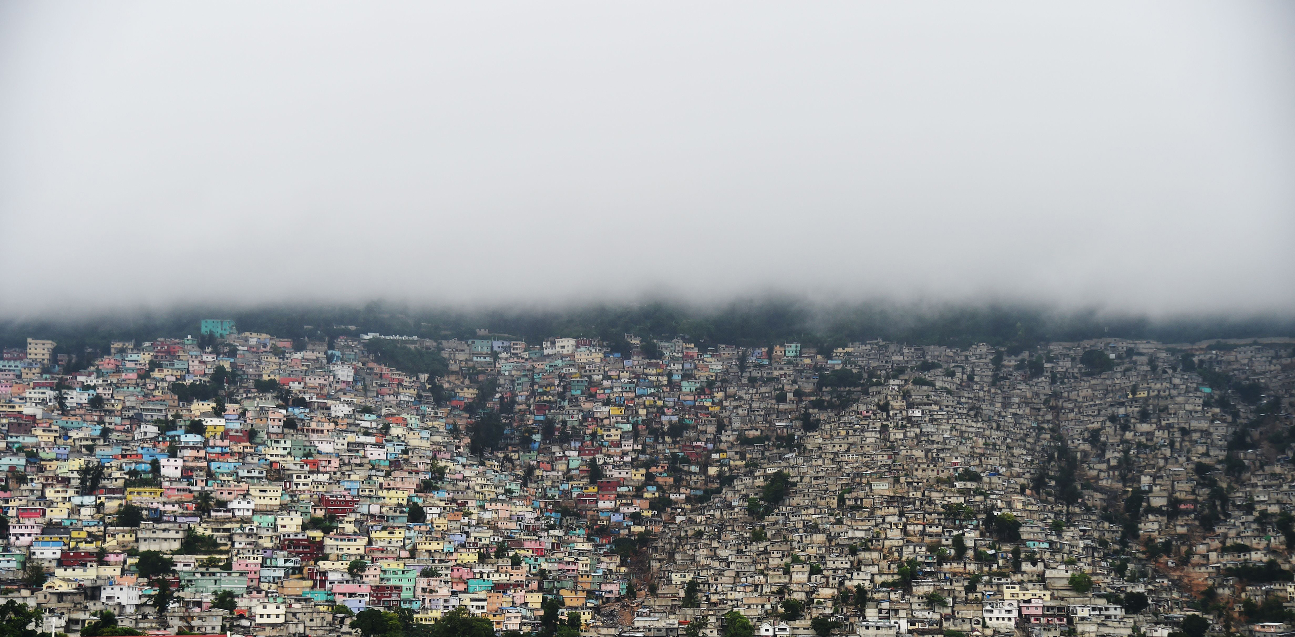 Clouds cover the mountains of Petion Ville rain fall in the Haitian capital of Port-au-Prince, on Oct. 3, 2016.