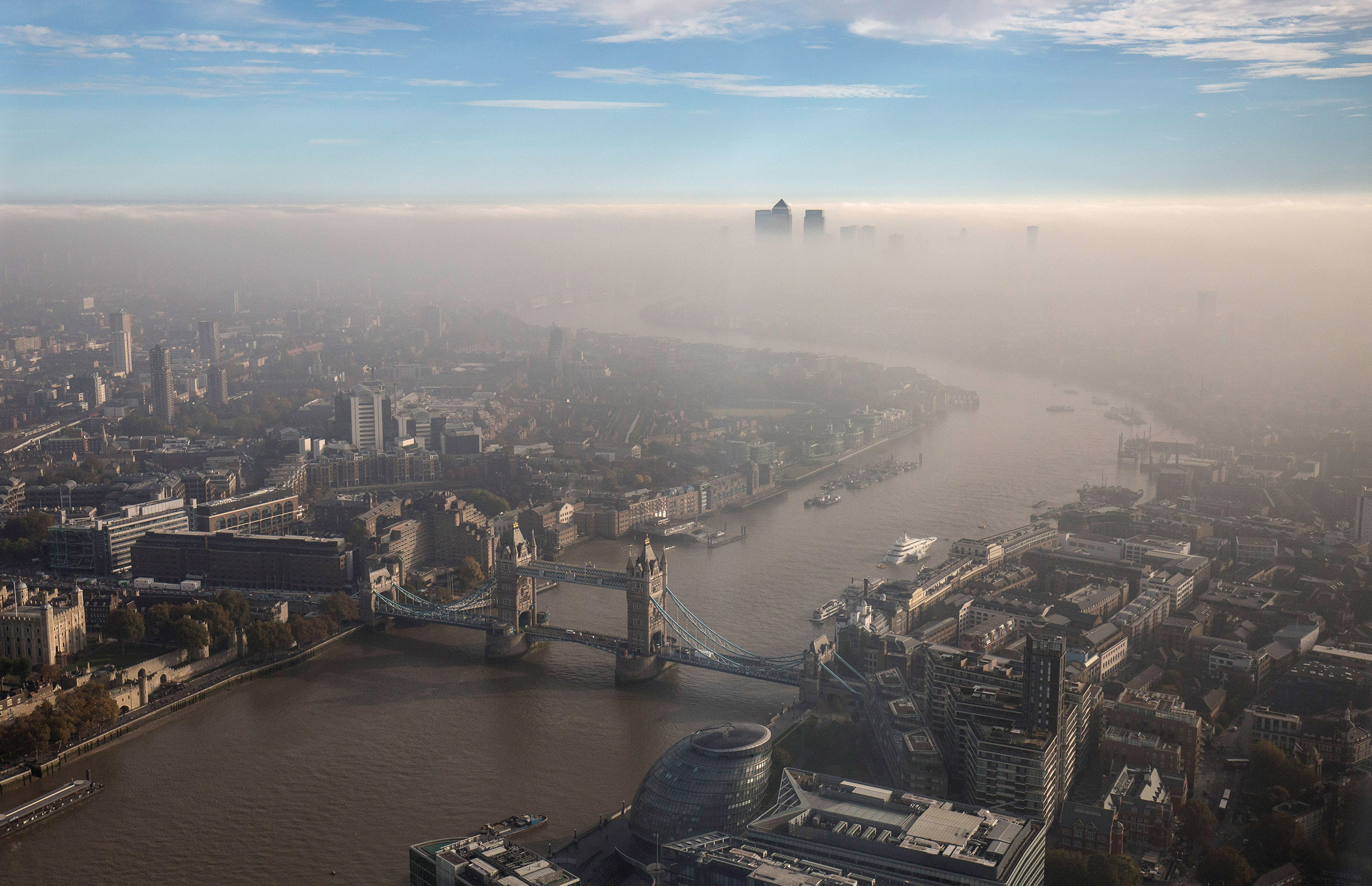 A general view of Tower Bridge and the city through the fog, seen from The View From The Shard in London, on Oct. 31, 2016.