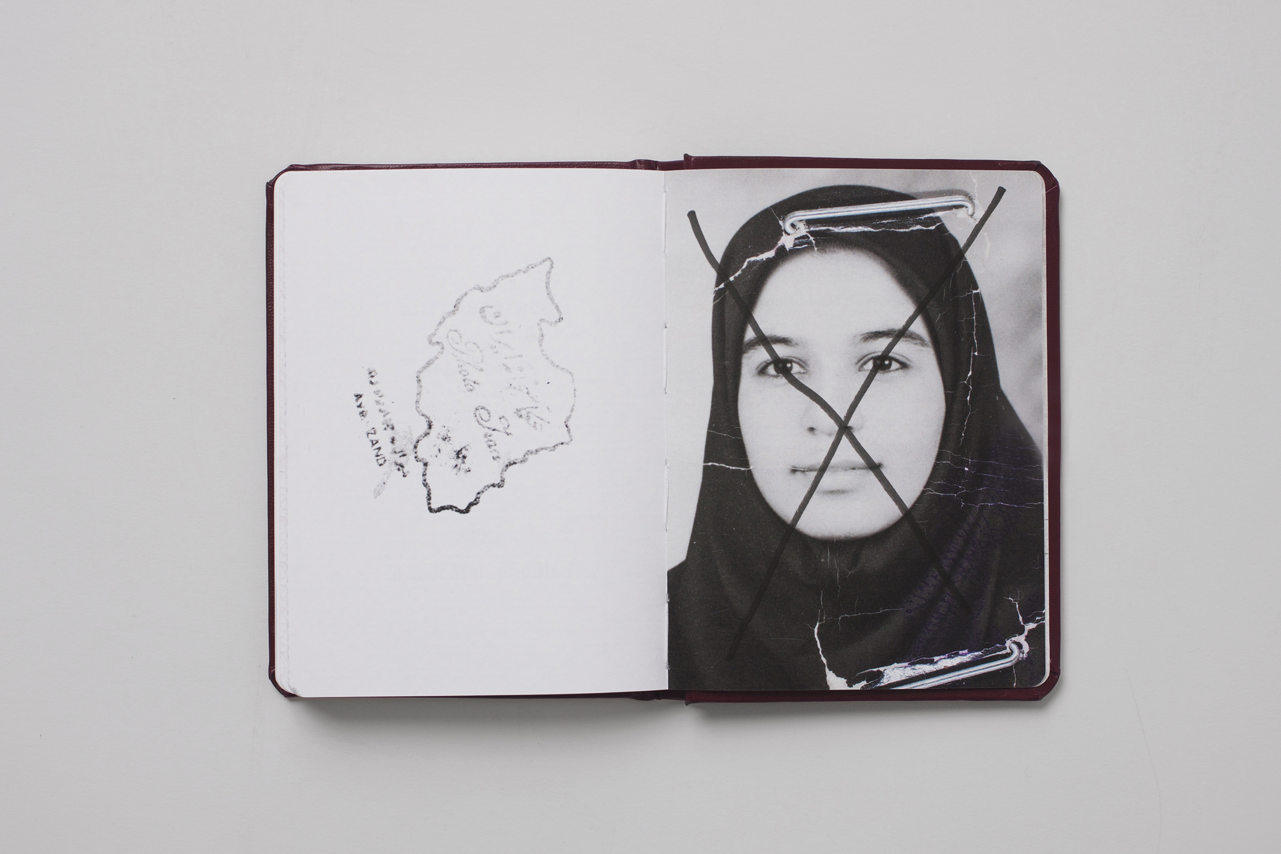 Selected by photography writer, curator and collector Larissa Leclair, the founder of Indie Photobook Library:  Valid for life, Shenasnameh originally is the name of the birth certificate issued in Iran, a passport-like document that must be updated during a woman's life depending on dress code laws. Each page of Mahmoodian's Shenasnameh portrays women dressed in hijab; no hair showing, presented in a simple, repetitive typology study. This design is interrupted by larger photographs, some with eyes, which may have been too expressive, scribbled out. The work reflects men that impose such constraints. Yet, the unique fingerprints and subtleties in expression hint at each woman's individuality, character and strength.""