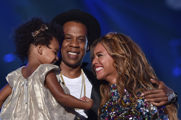 (L-R) Blue Ivy Carter, Jay Z and Beyonce onstage during the 2014 MTV Video Music Awards at The Forum on August 24, 2014 in Inglewood, California.
