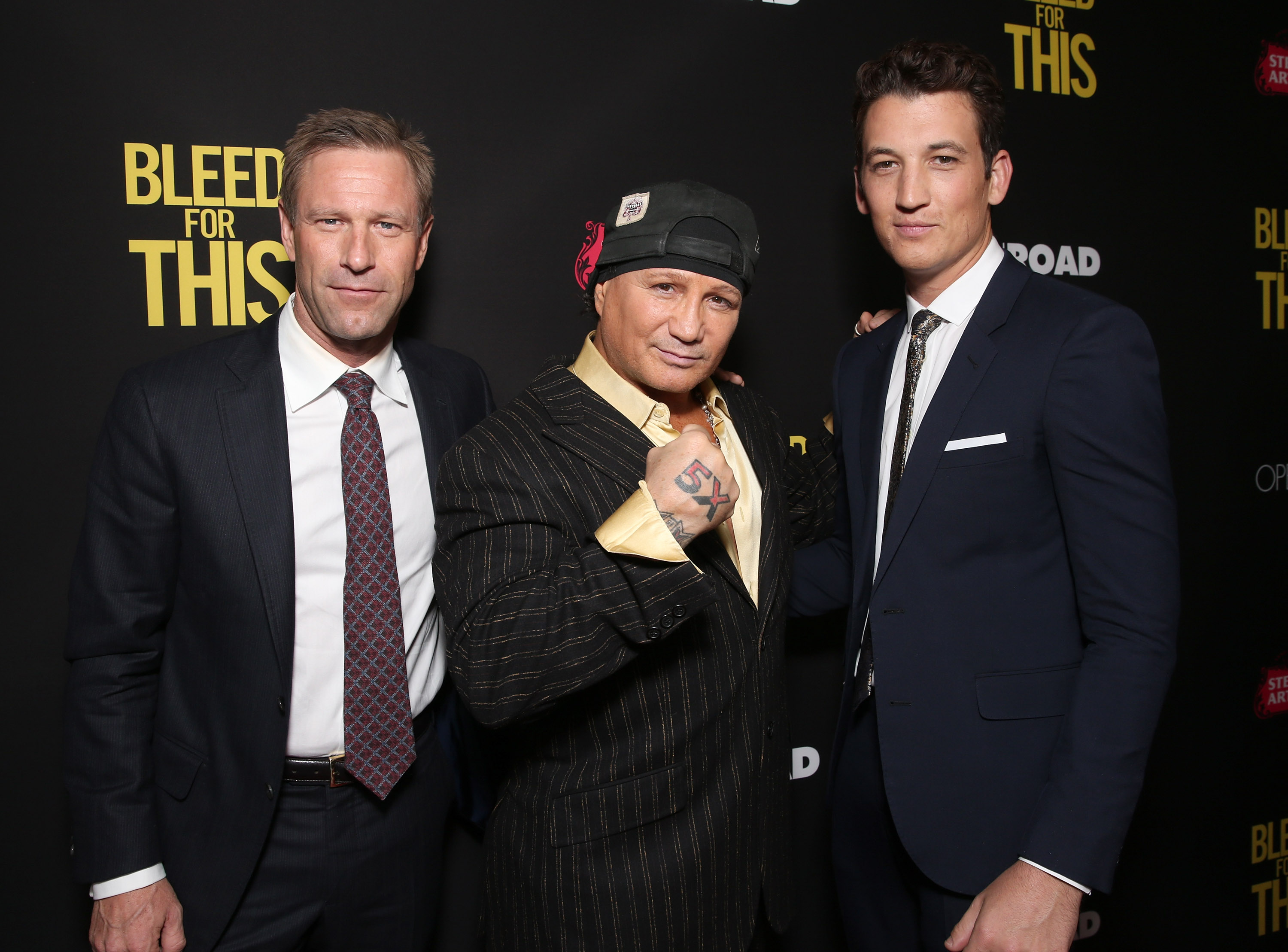 Aaron Eckhart, Vinny Paz and Miles Teller attend the Premiere of  Bleed For This  on November 2, 2016 in Beverly Hills, California.