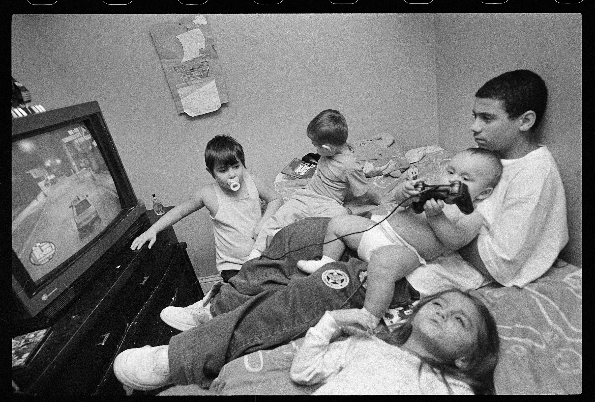 Little John, Little Jesse, Christy, Tony, and their friend Patrick                                playing Grand Theft Auto: San Andreas, 2004.