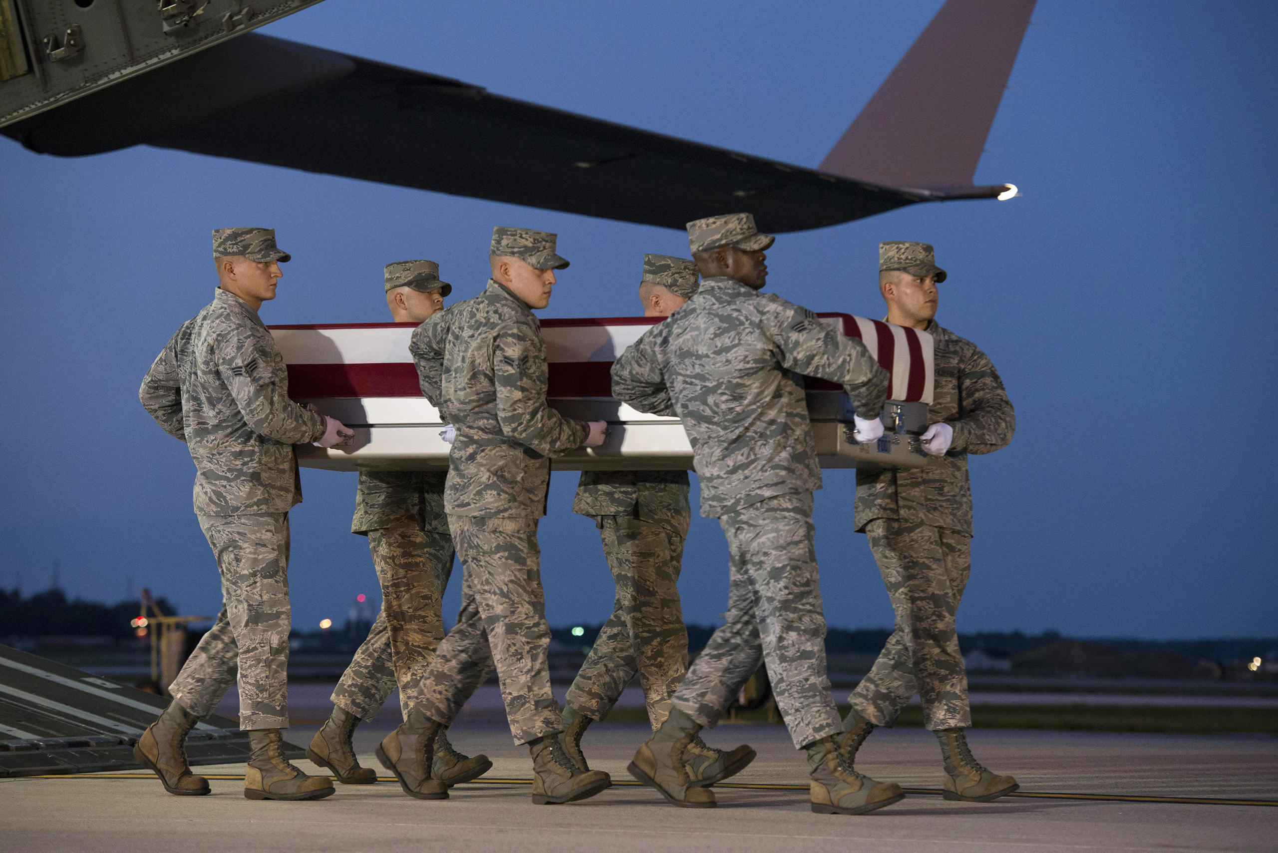The body of Major Troy Gilbert returns to U.S. soil at Dover Air Force Base in Delaware in October after being held by Iraqis since 2006