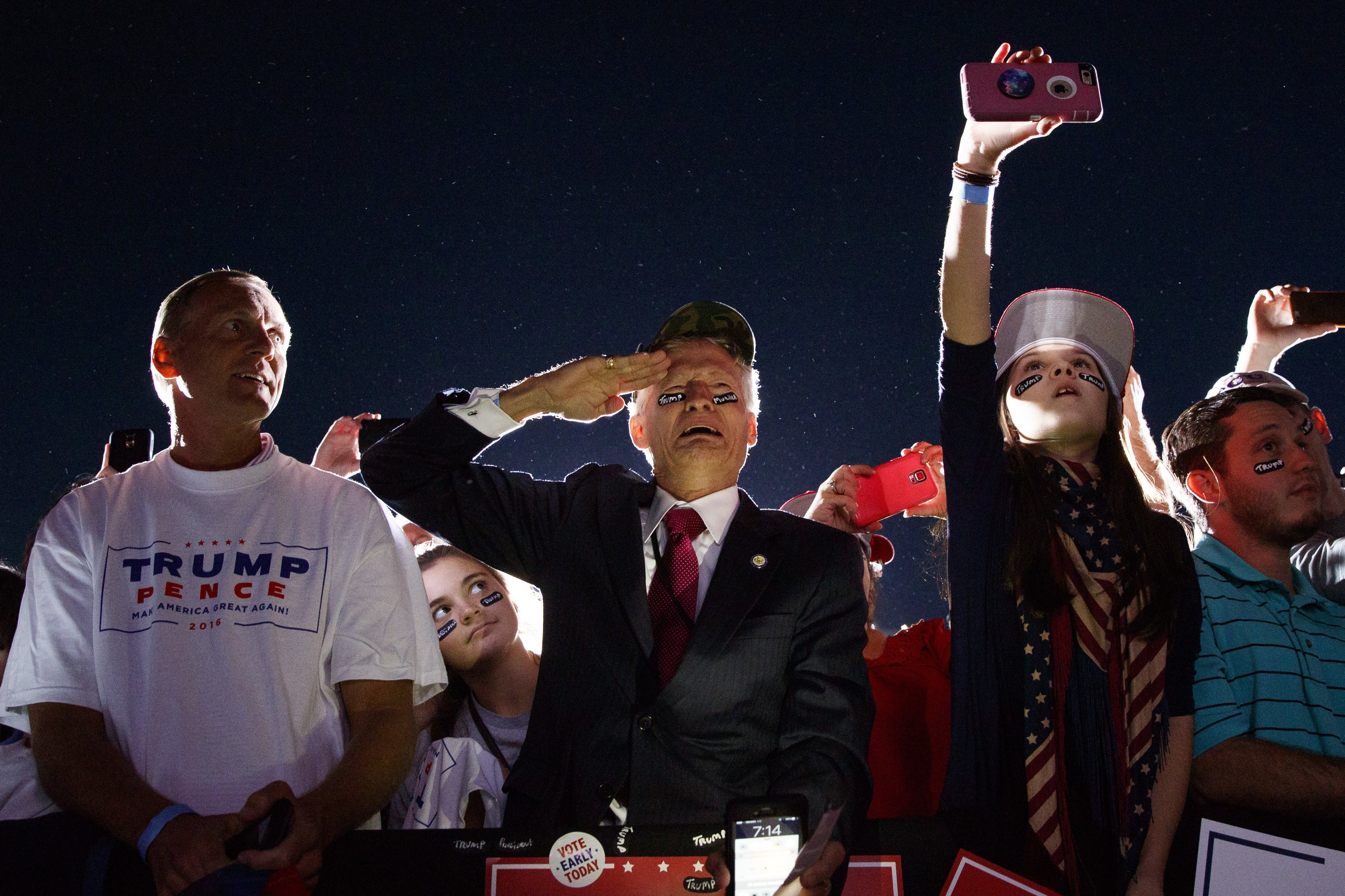 Jeff Muller of Wilmington, N.C., salutes as Donald Trump arrives at a campaign rally in Kinston, N.C., on Oct. 26, 2016.