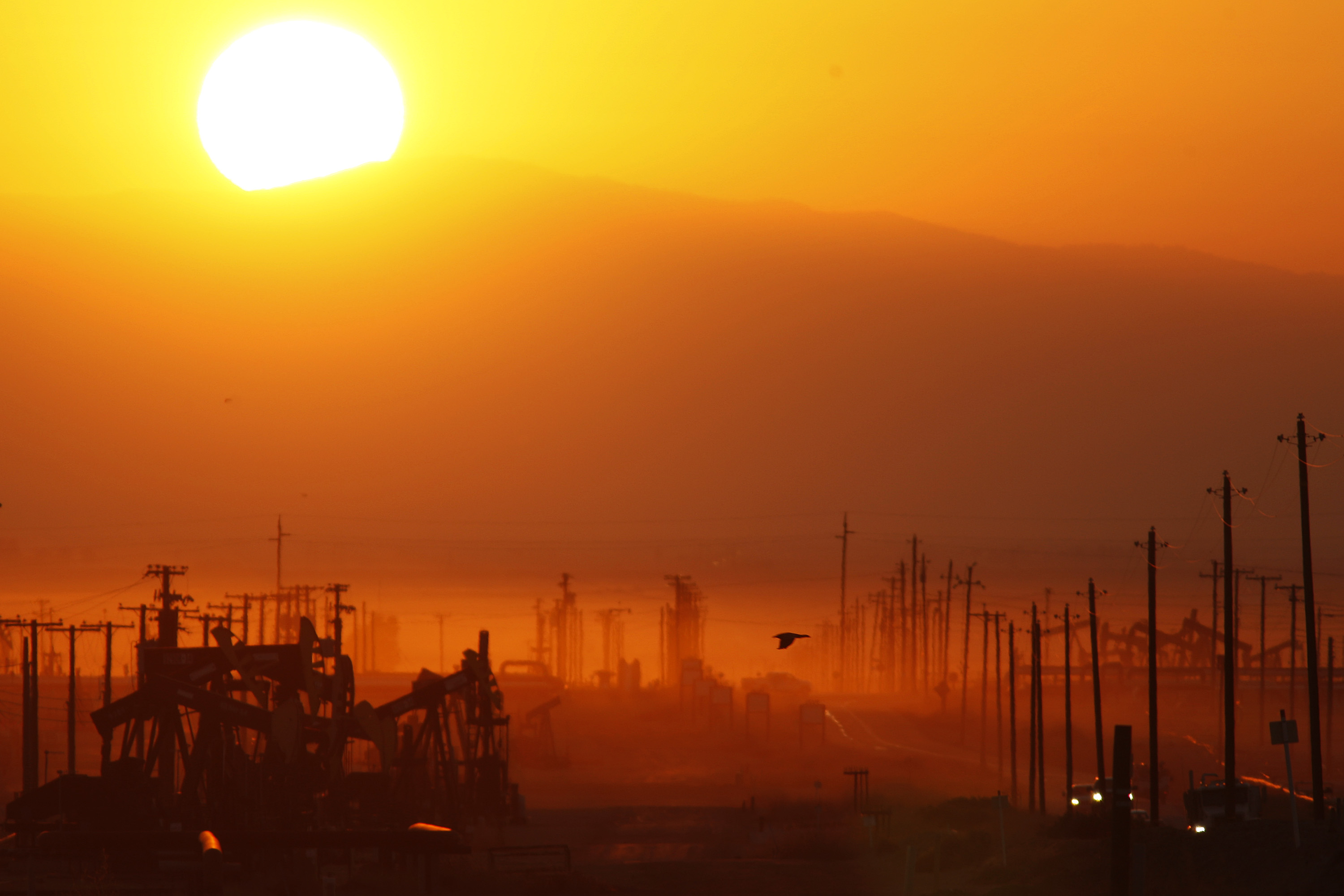 The sun rises over an oil field over the Monterey Shale formation where gas and oil extraction using hydraulic fracturing, or fracking, is on the verge of a boom on March 24, 2014 near Lost Hills, California.
