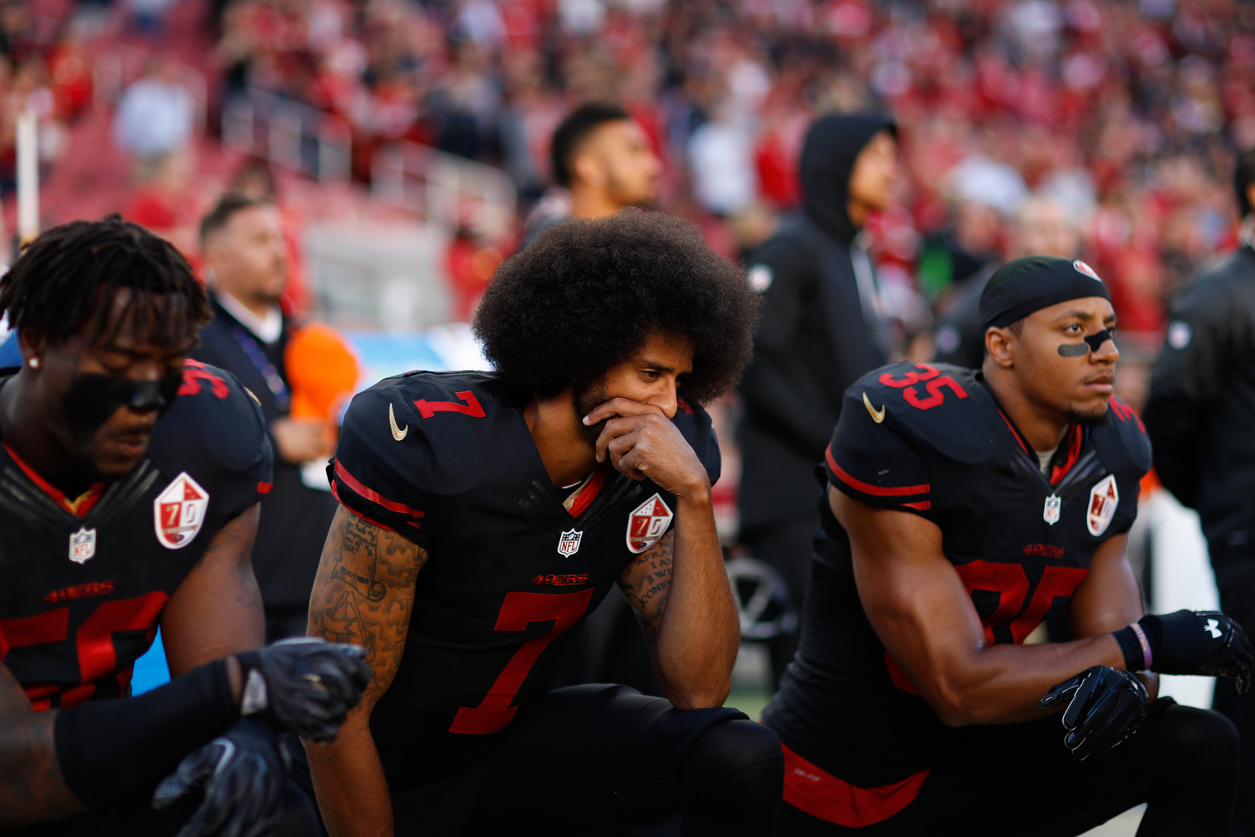 San Francisco 49ers quarterback Colin Kaepernick (7) kneels during the National Anthem prior to an NFL football game against the Arizona Cardinals on Oct. 6, 2016 in Santa Clara, Calif.
