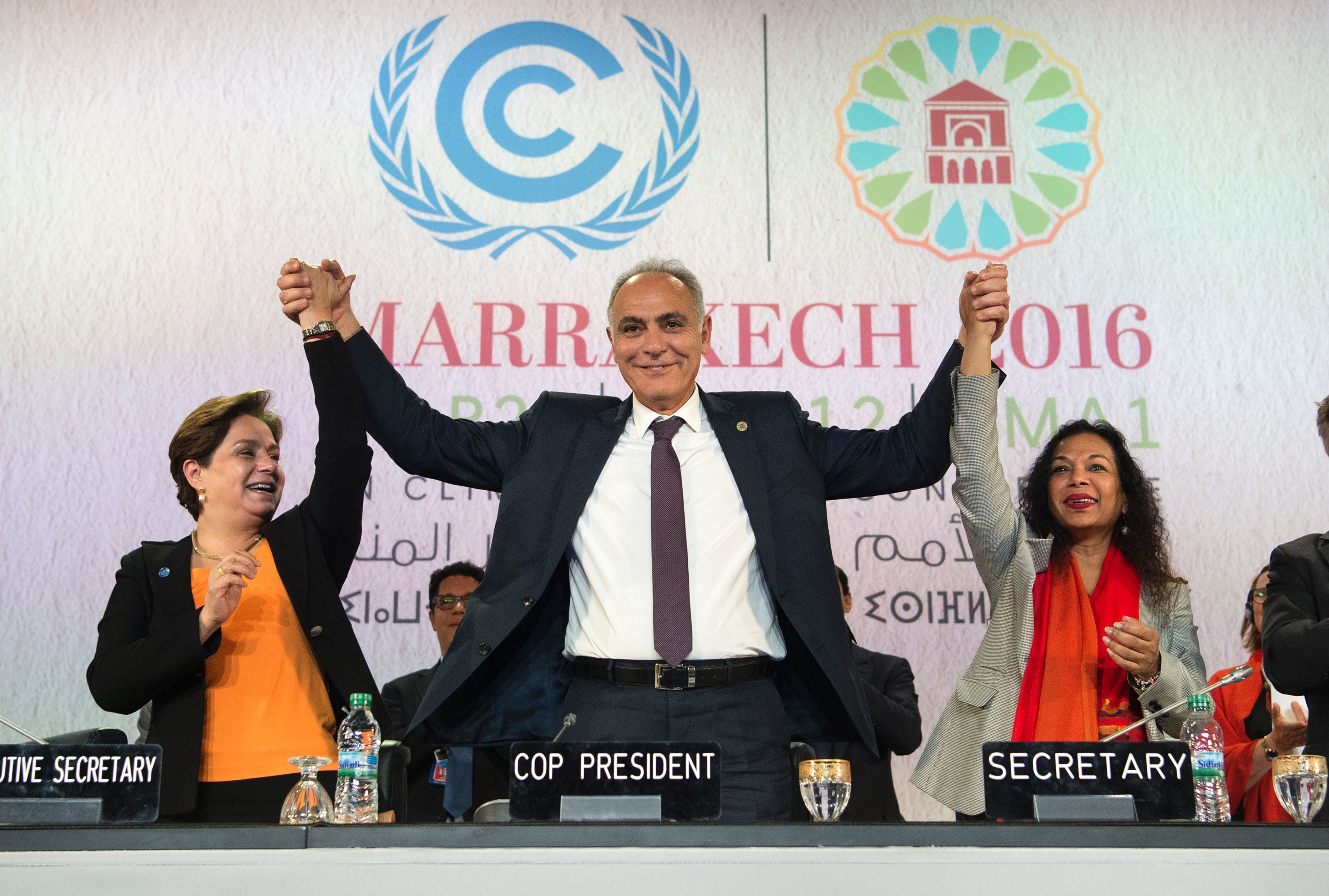 COP 22 president Salaheddine Mezouar poses for a picture with COP22 Executive Secretary Patricia Espinosa, and COP22 Secretary during a press conference at the COP22 climate conference on Nov. 17, 2016, in Marrakesh.